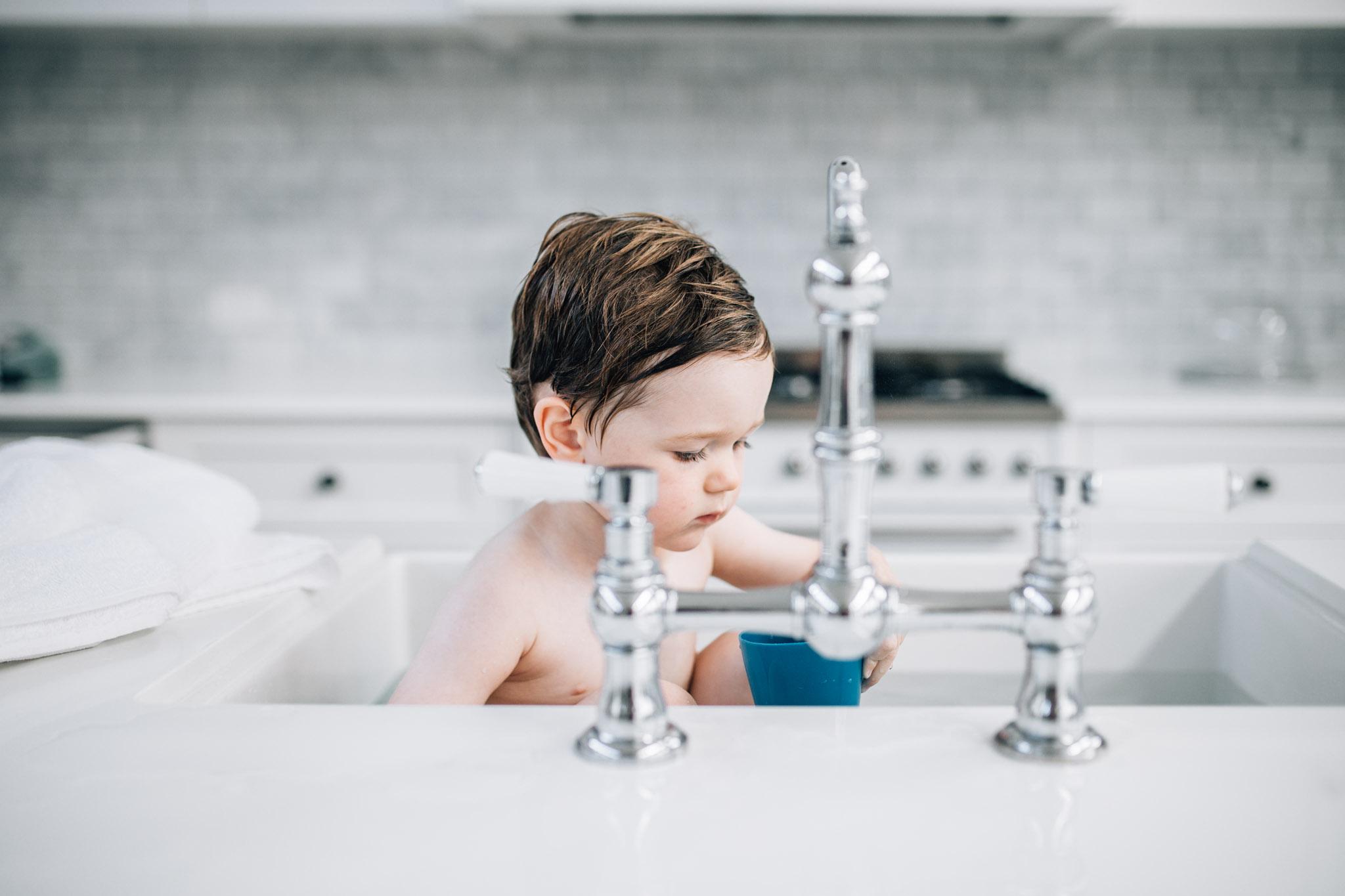 boy bathing in sink II (1 of 1).jpg
