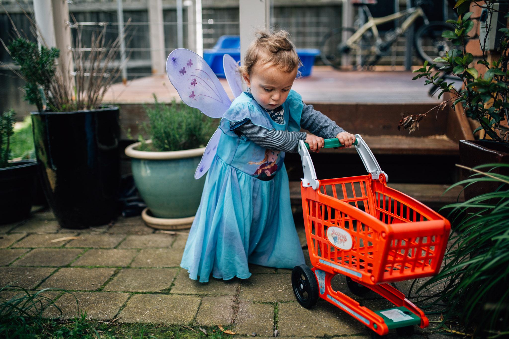 little girl dressed as fairy pushig shopping trolley (1 of 1).jpg