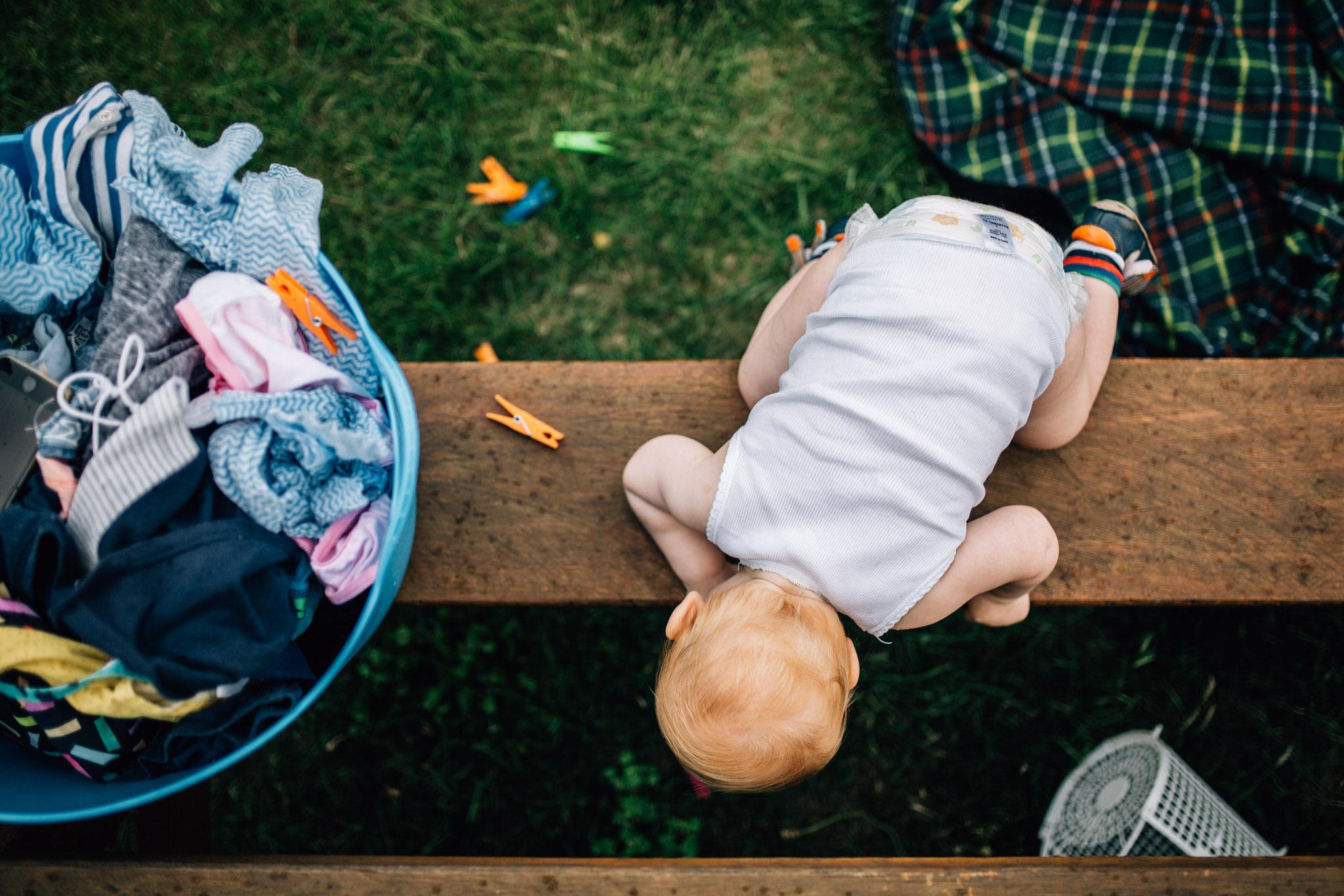 little boy climbing up on picnic bench (1 of 1).jpg