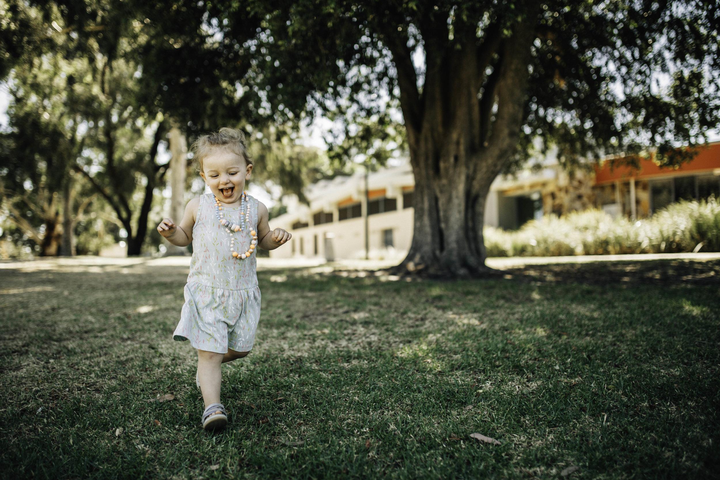 little-girl-in-green-frock-running-over-grass.jpg
