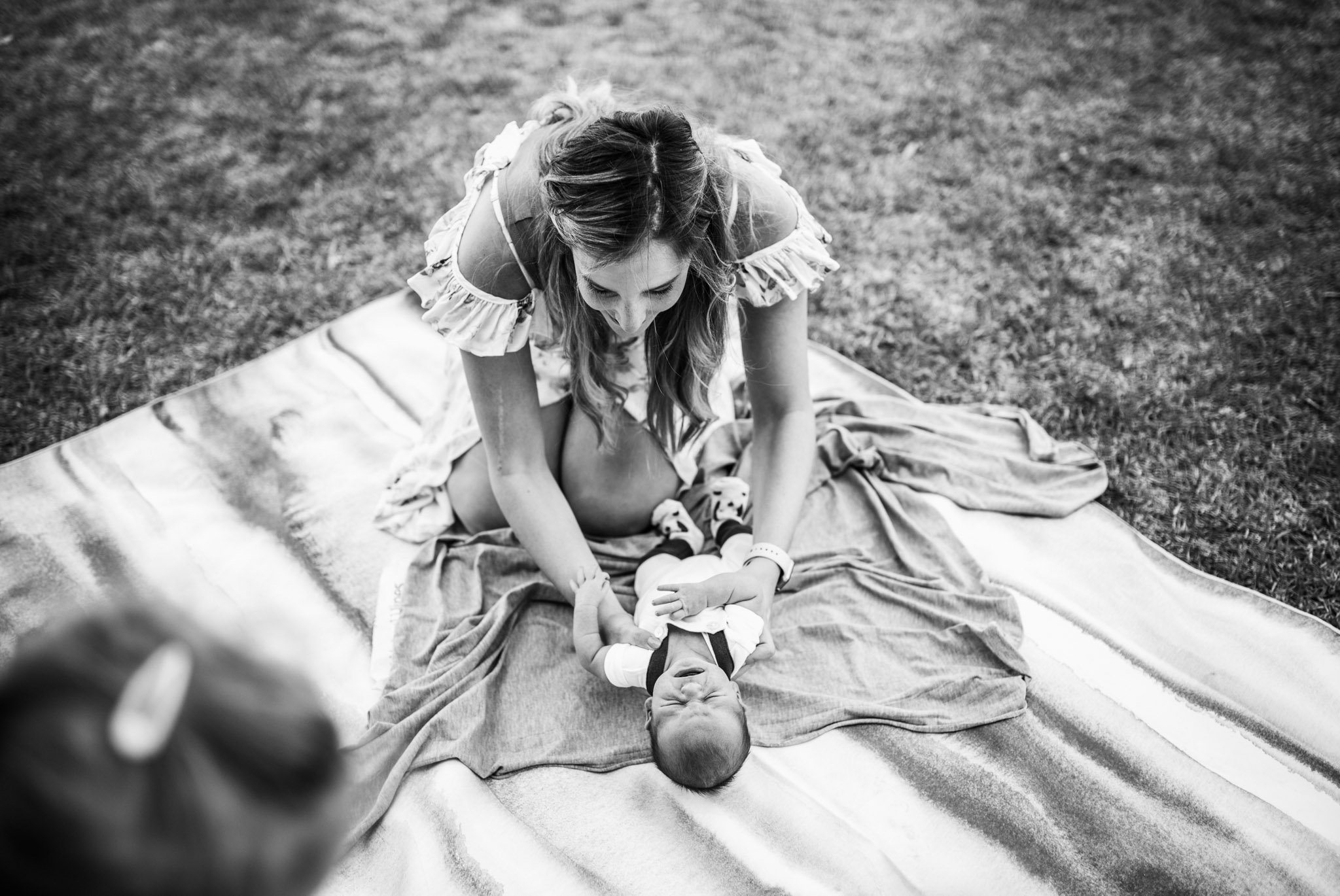 mother-wrapping-newborn-on-picnic-rug (1 of 1).jpg