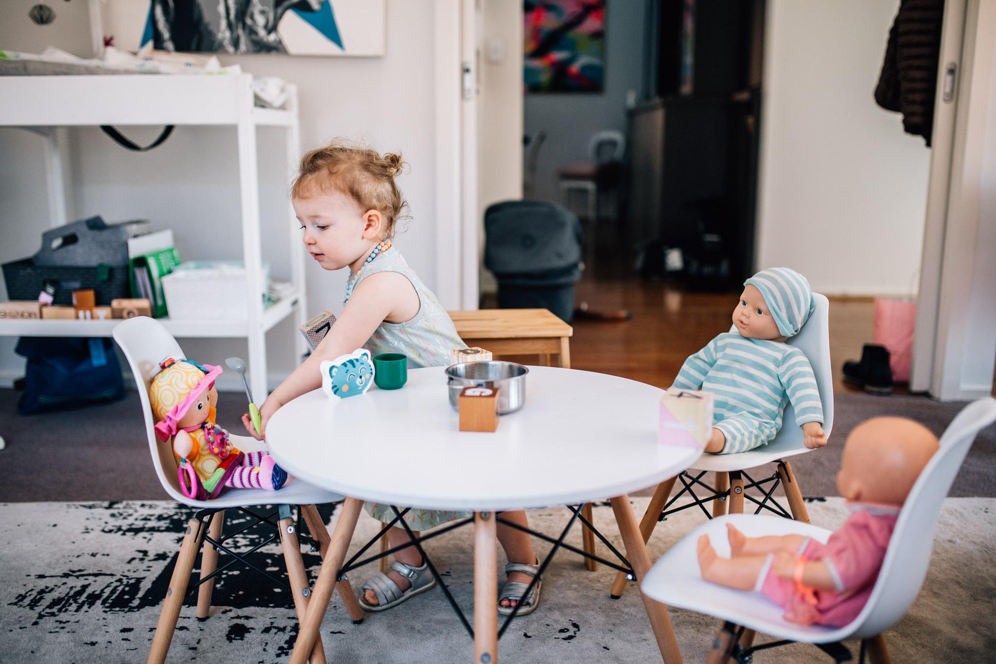 little-girl-feeding-toys-lunch (1 of 1).jpg