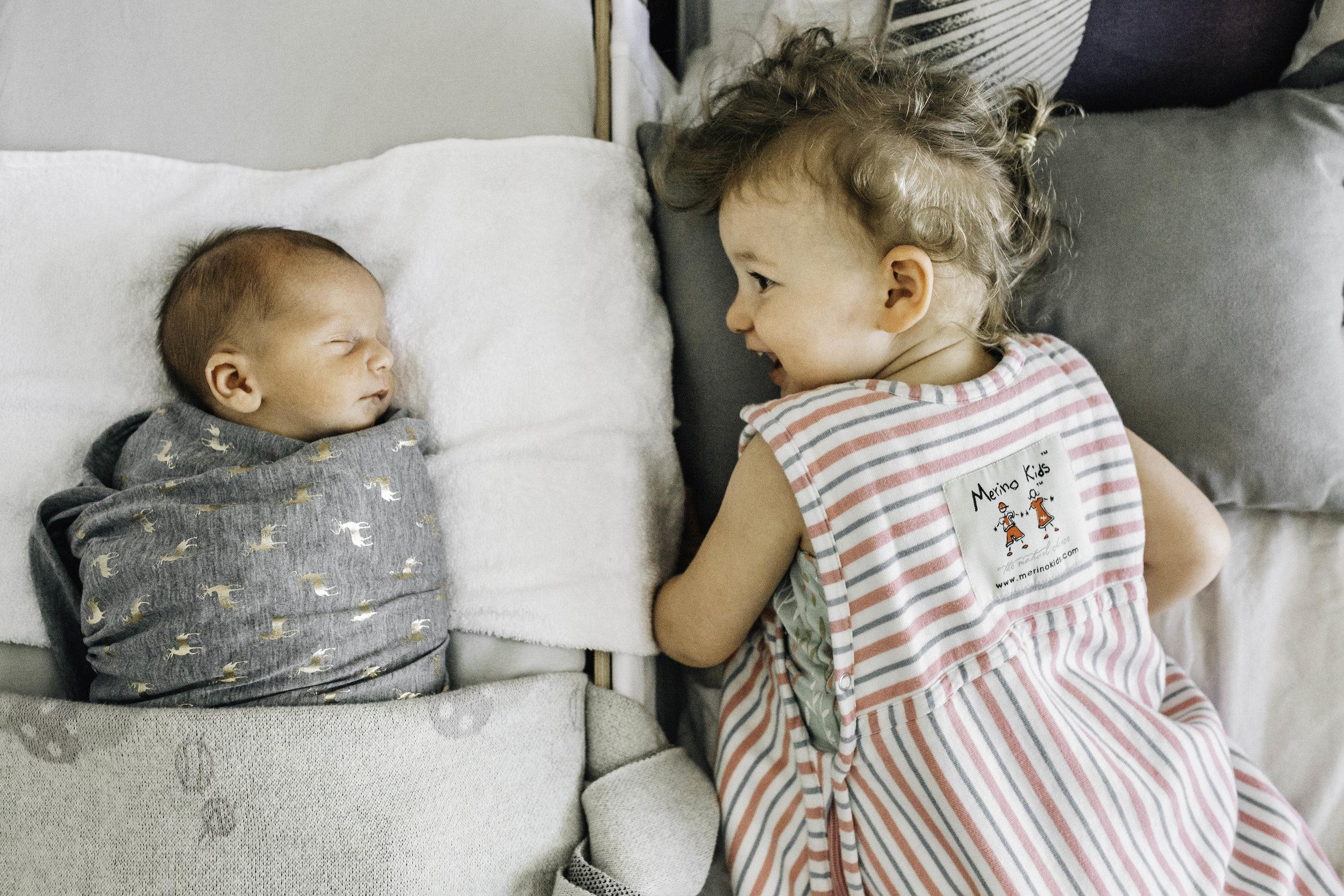 baby-sleeping-next-to-toddler-sister.jpg