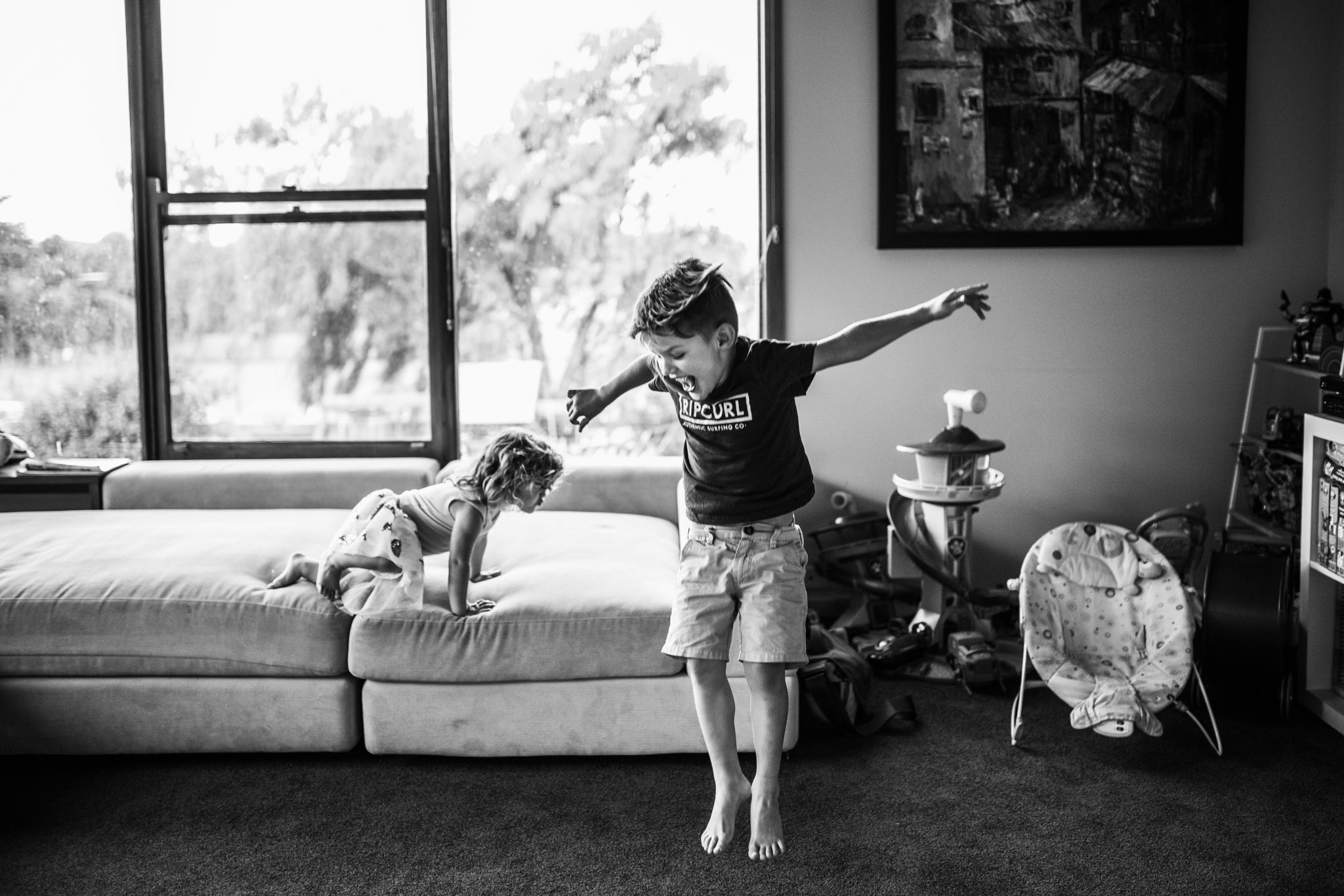 little-boy-jumping-off-sofa (1 of 1).jpg