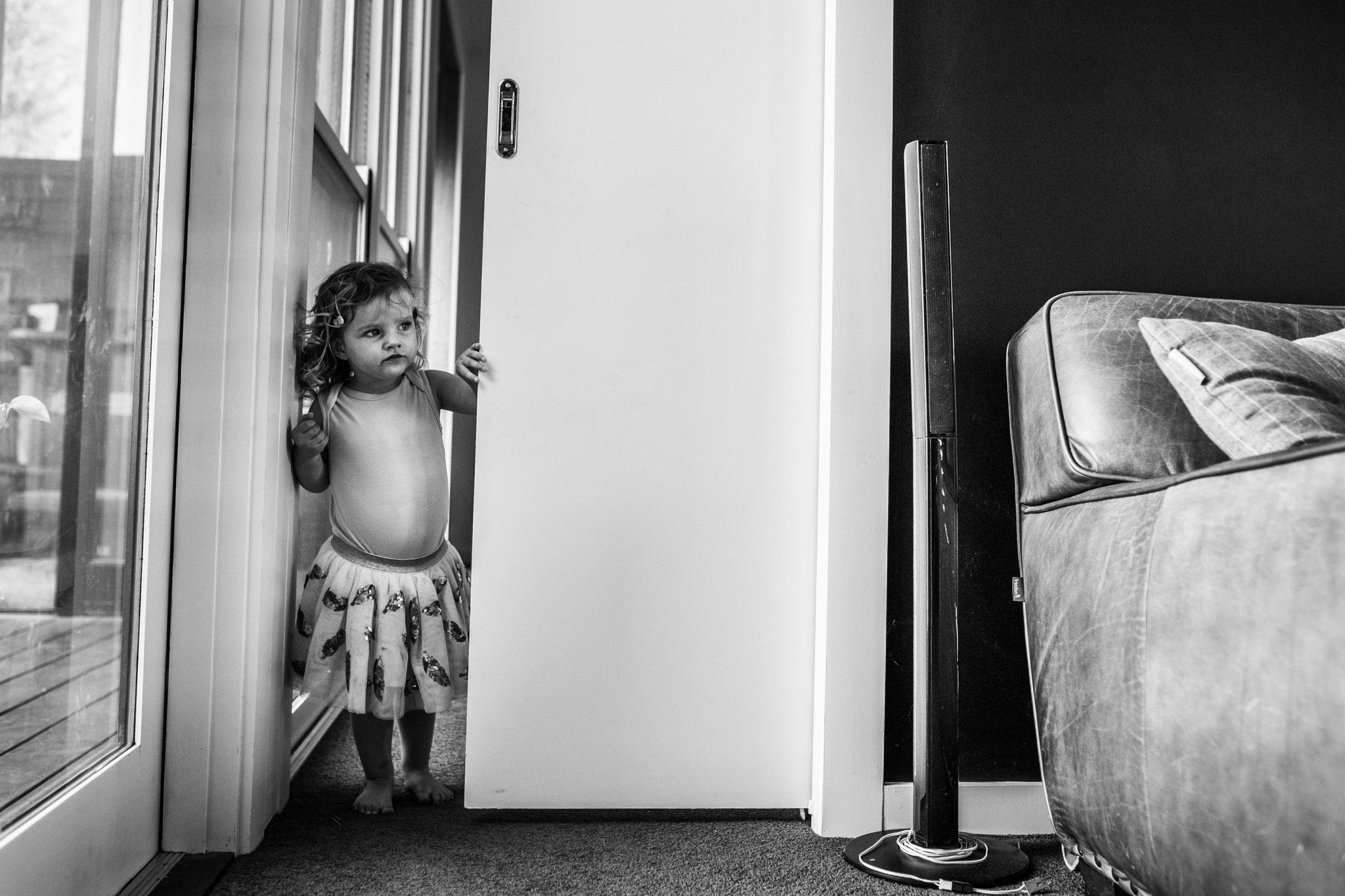 little-girl-peeking-through-living-room-door (1 of 1).jpg