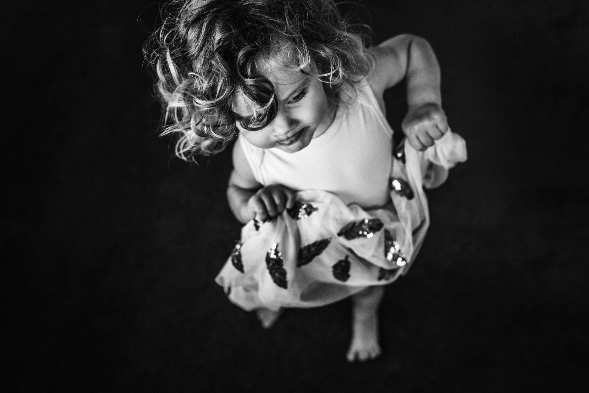 little-girl-dancing-on-carpeted-floor.jpg