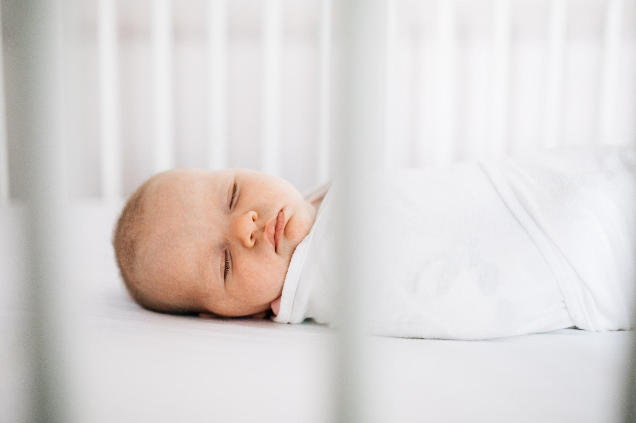 swaddled-baby-sleeping-in-crib (1 of 1).jpg