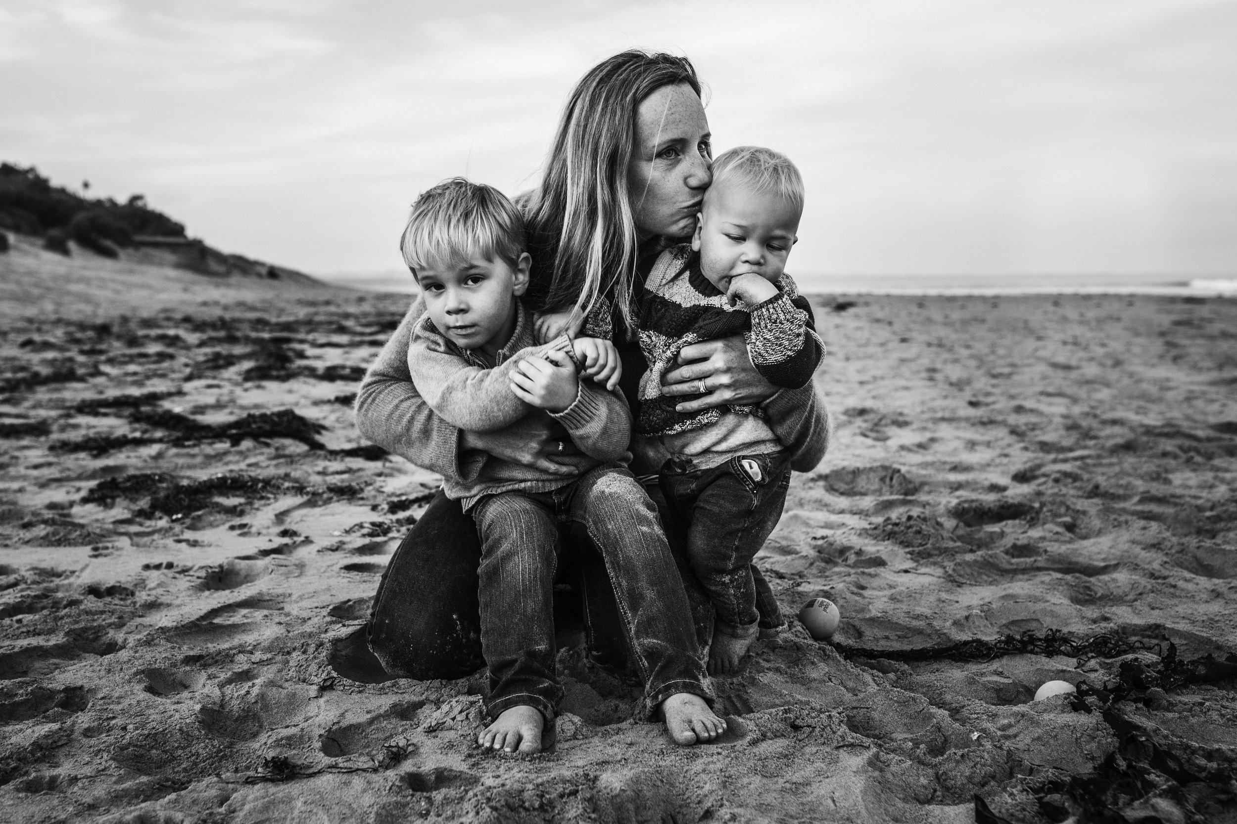 mother-with-two-tiny-sons-on-beach.jpg