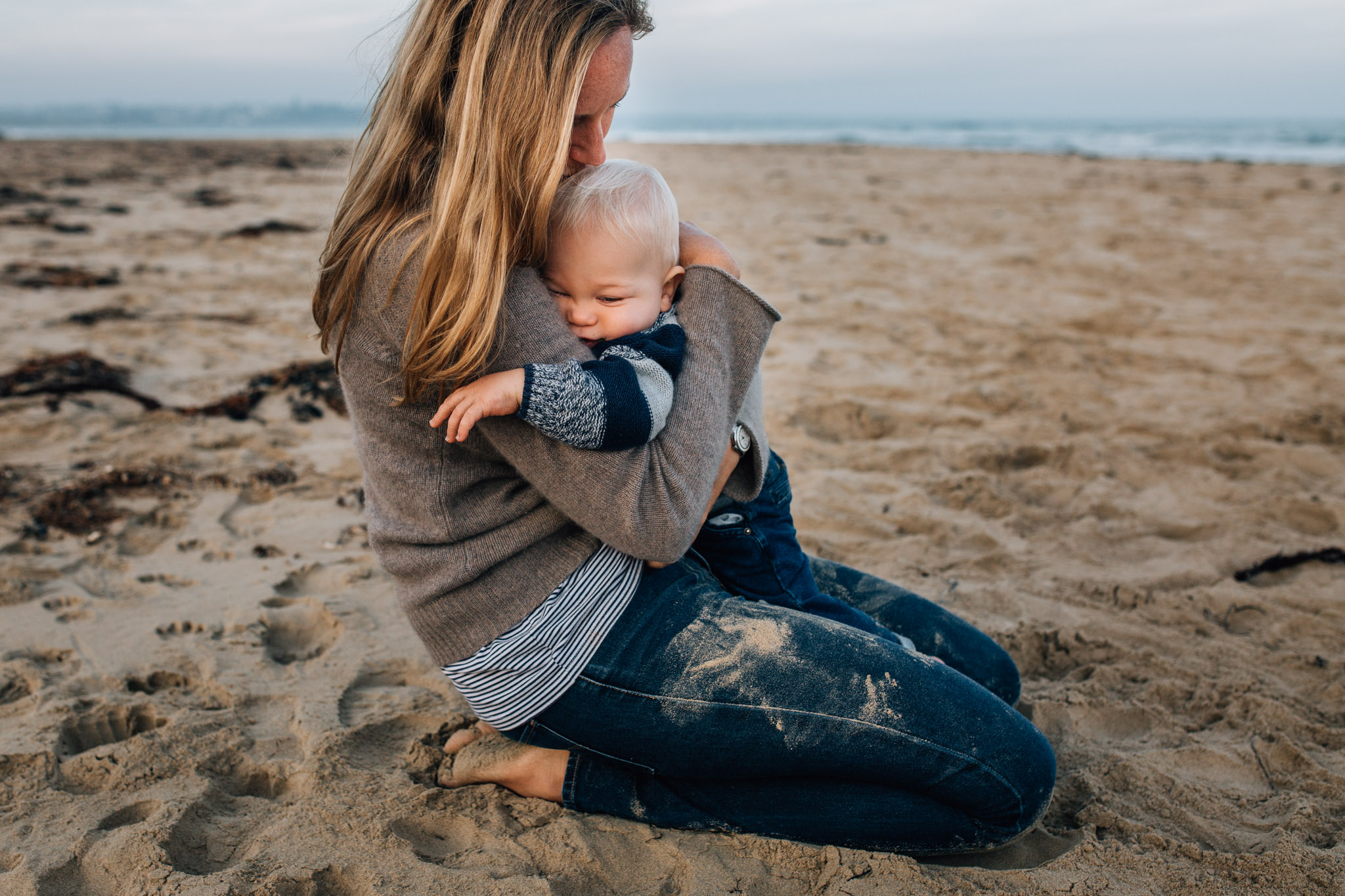 mother-and-son-hugging-on-sand (1 of 1).jpg
