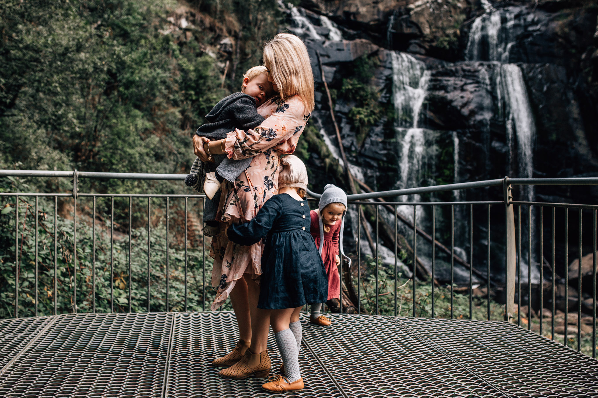 mother-with-her-babies-in-front-of-waterfall (1 of 1).jpg