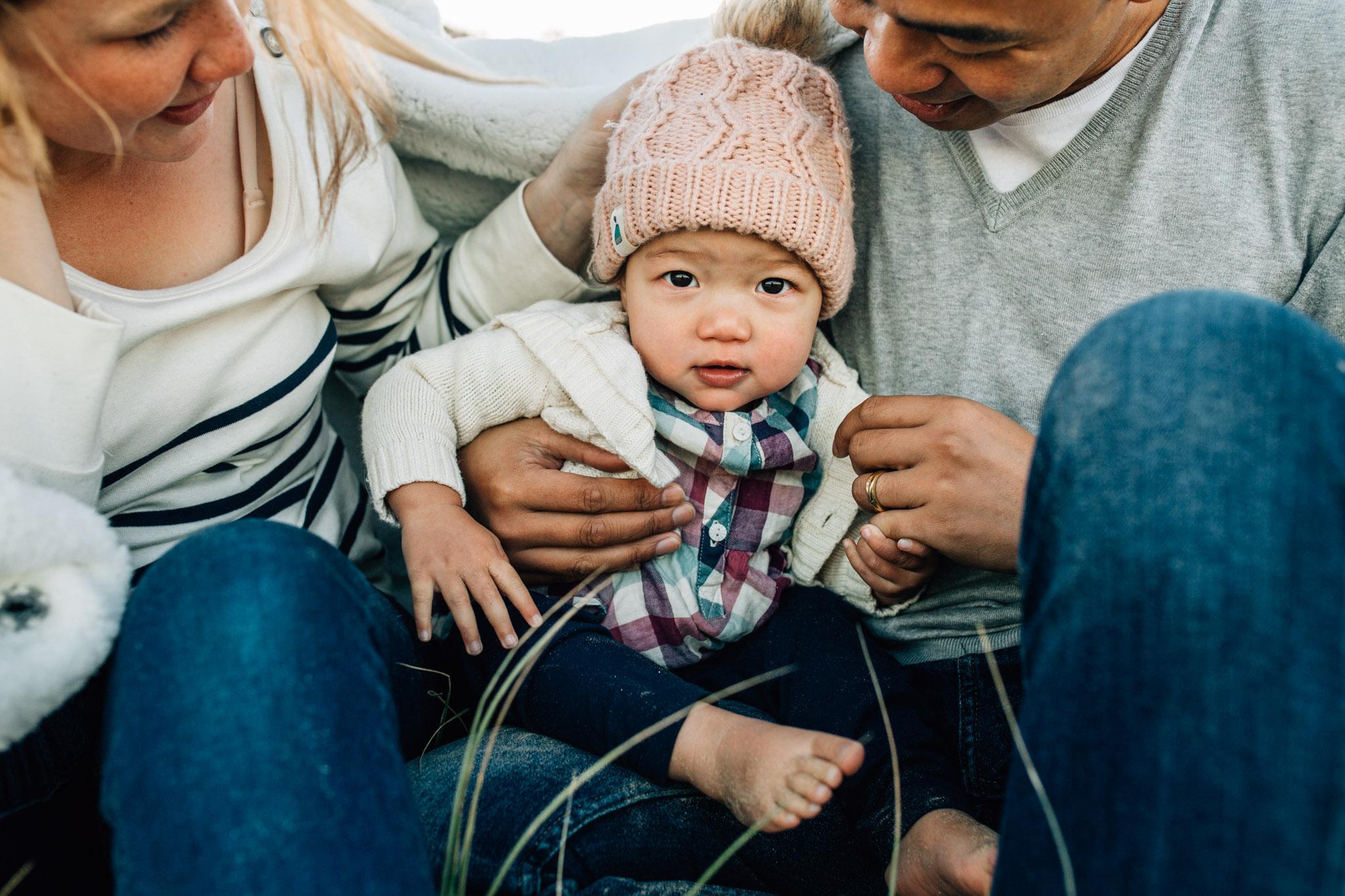 little-girl-resing-in-parents-lap-I (1 of 1).jpg