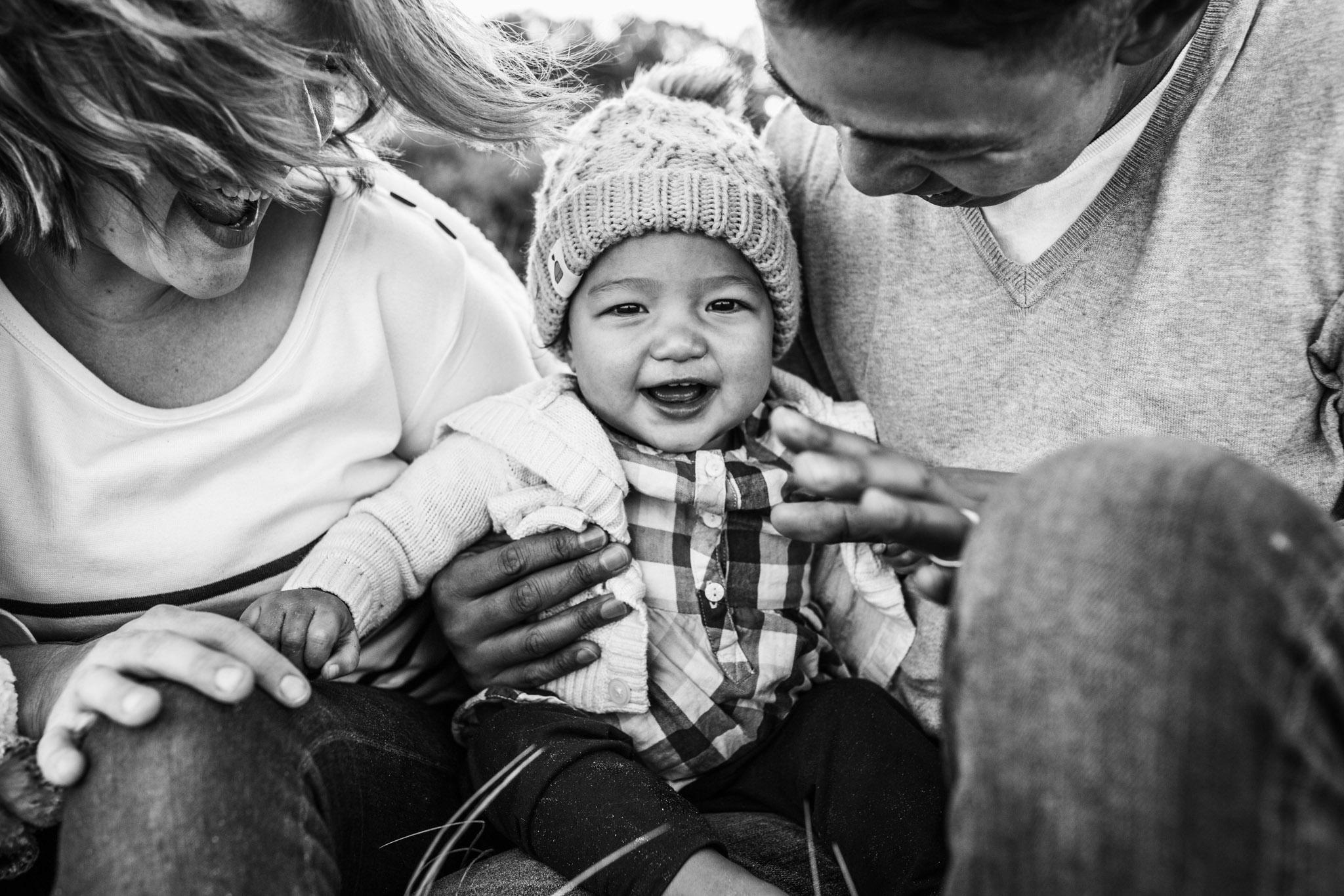 little-girl-resing-in-parents-lap-III (1 of 1).jpg