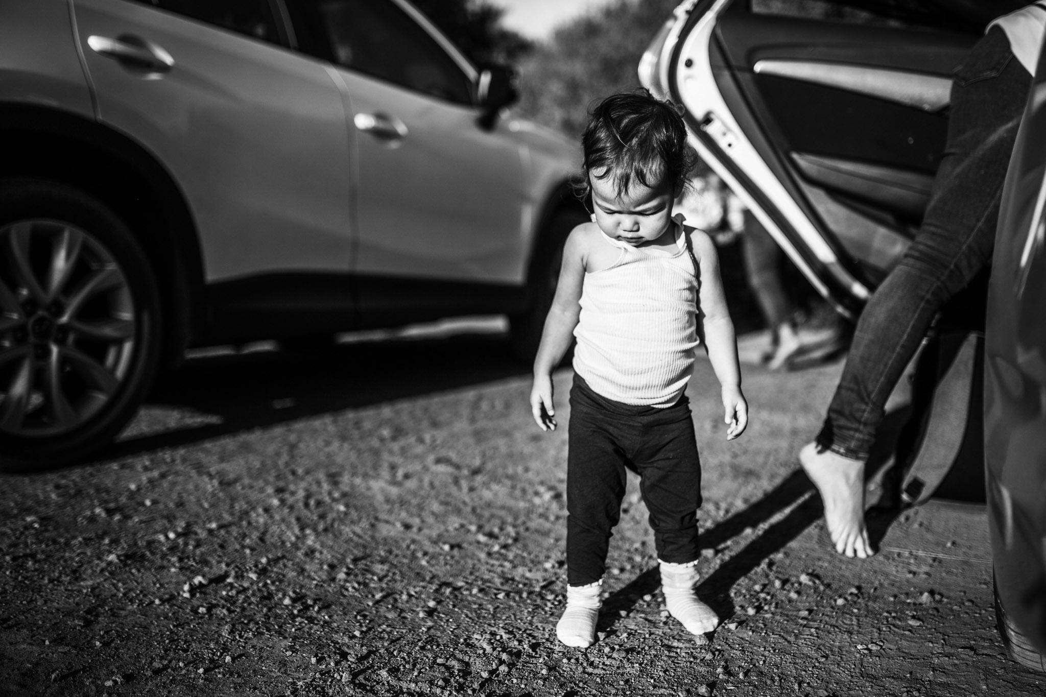 toddler-girl-beside-car-BW (1 of 1).jpg