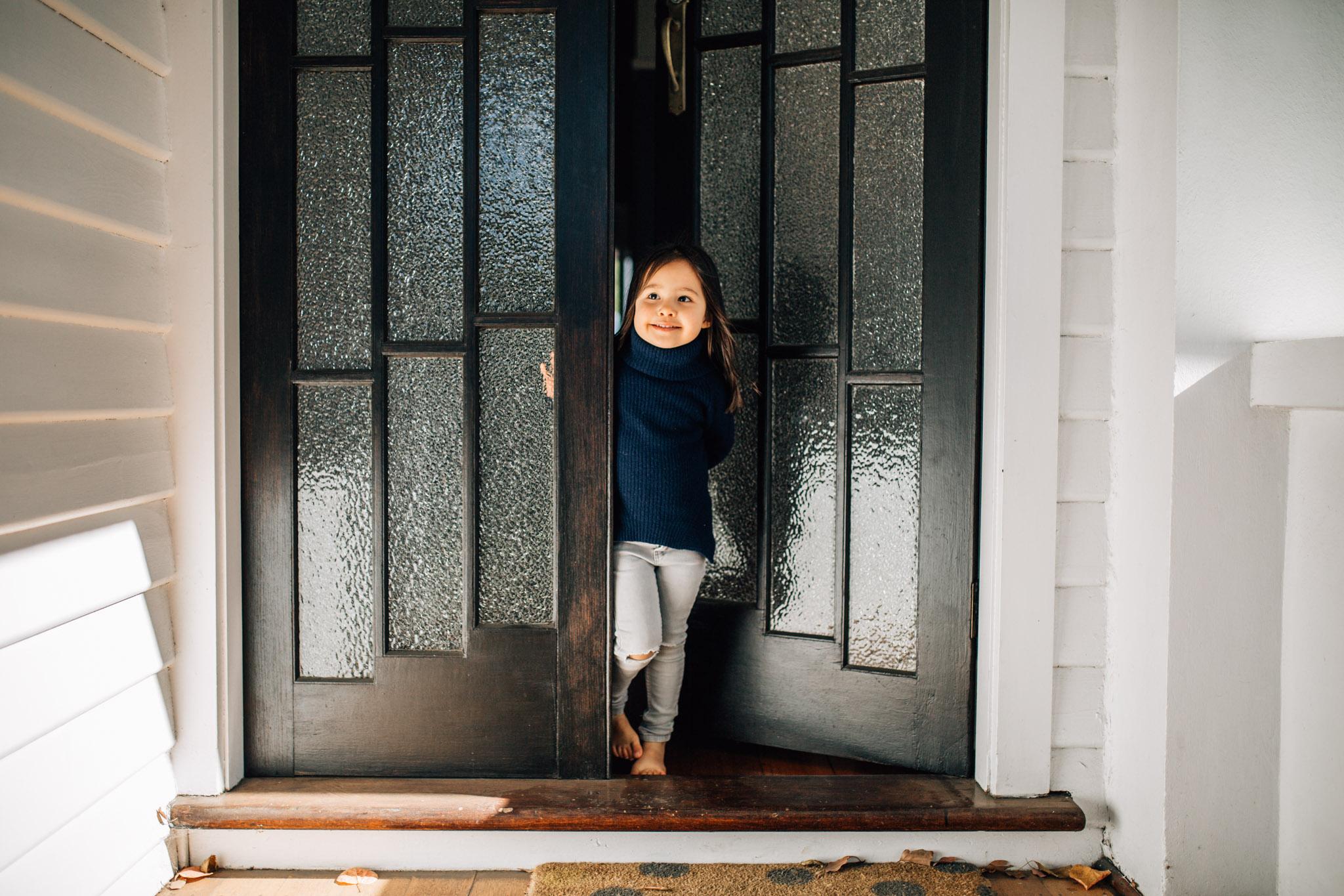 little-girl-in-front-garden-door (1 of 1).jpg