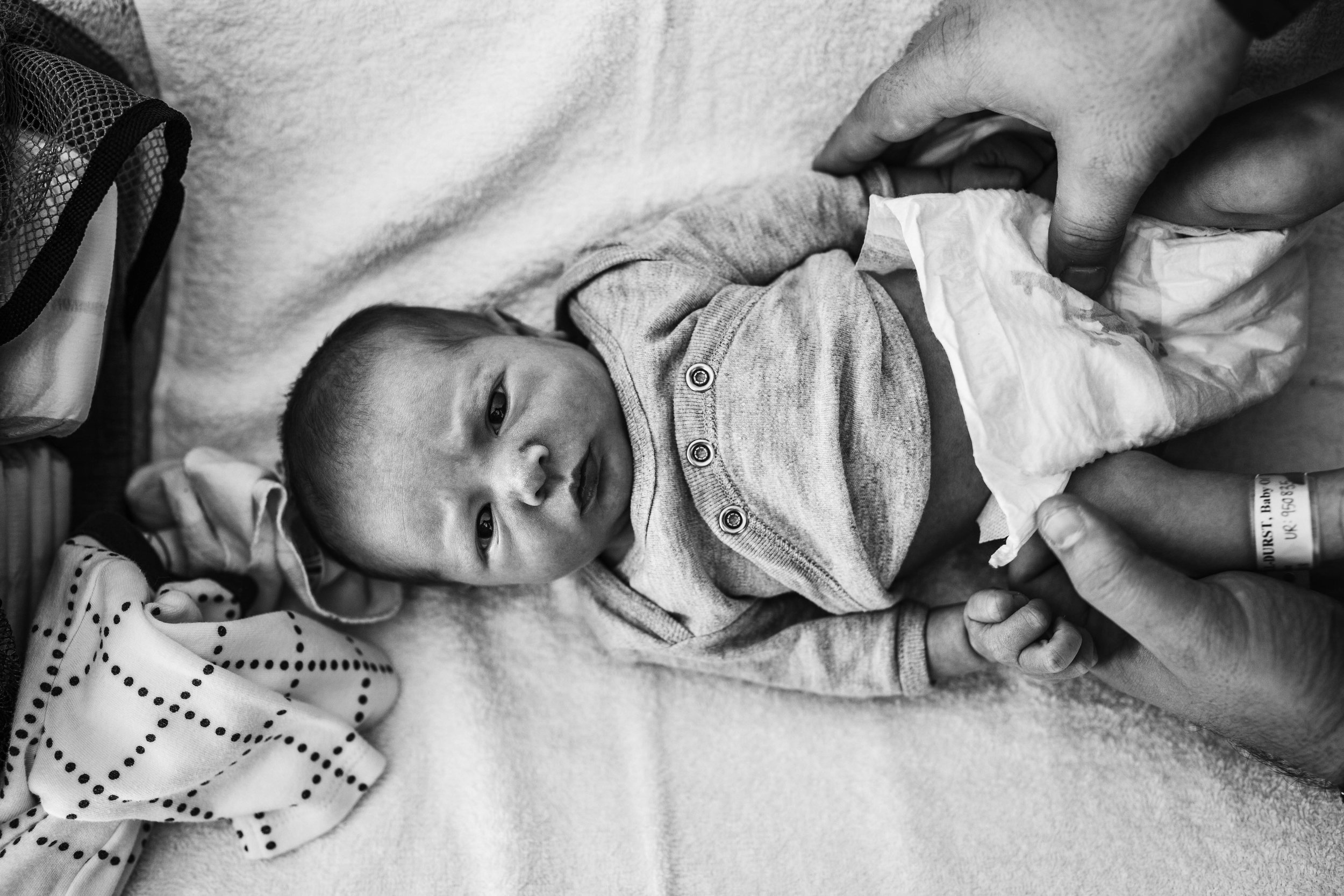 baby-boy-nappy-change-looking-at-camera.jpg
