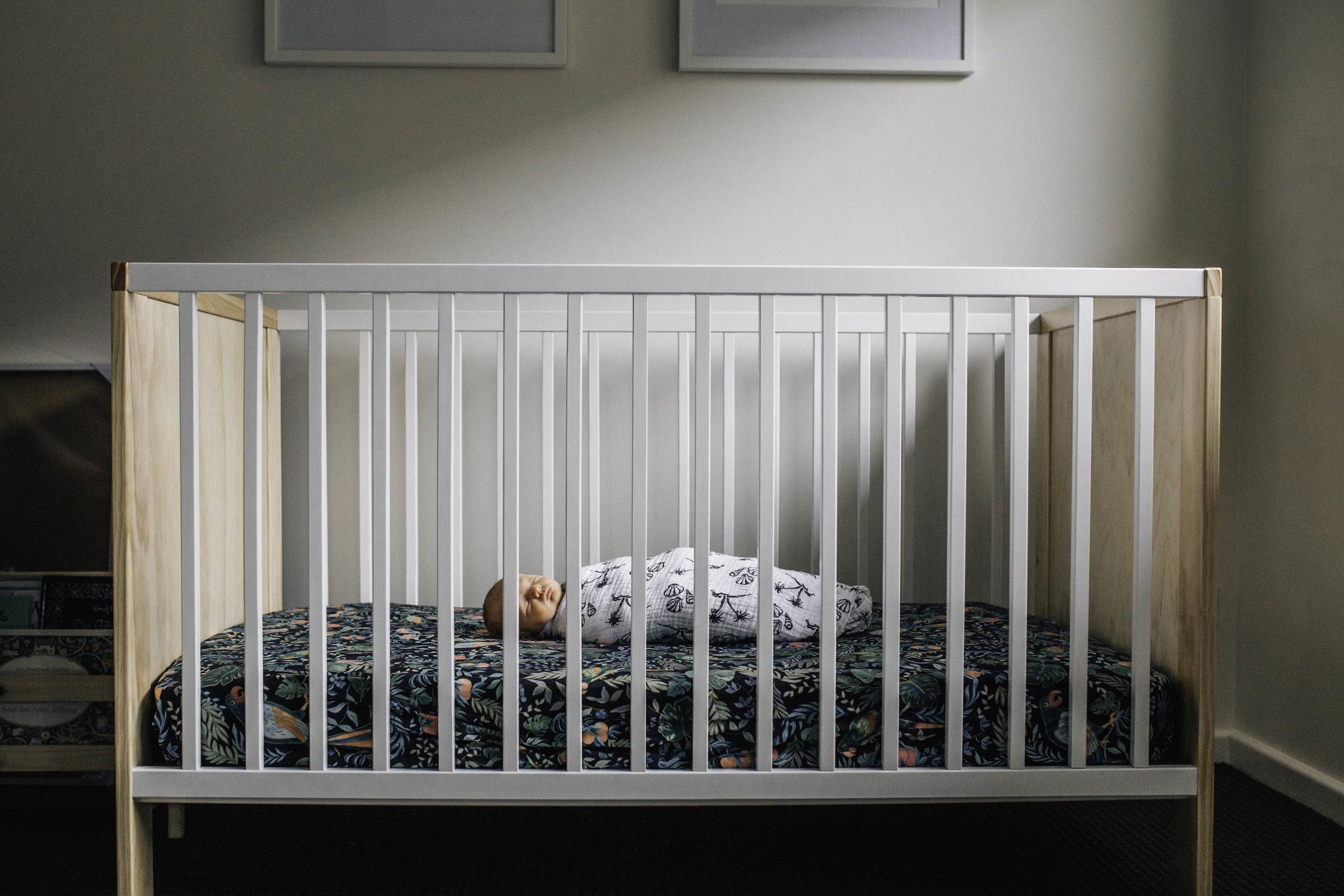 baby-sleeping-in-cot-in-nursery.jpg