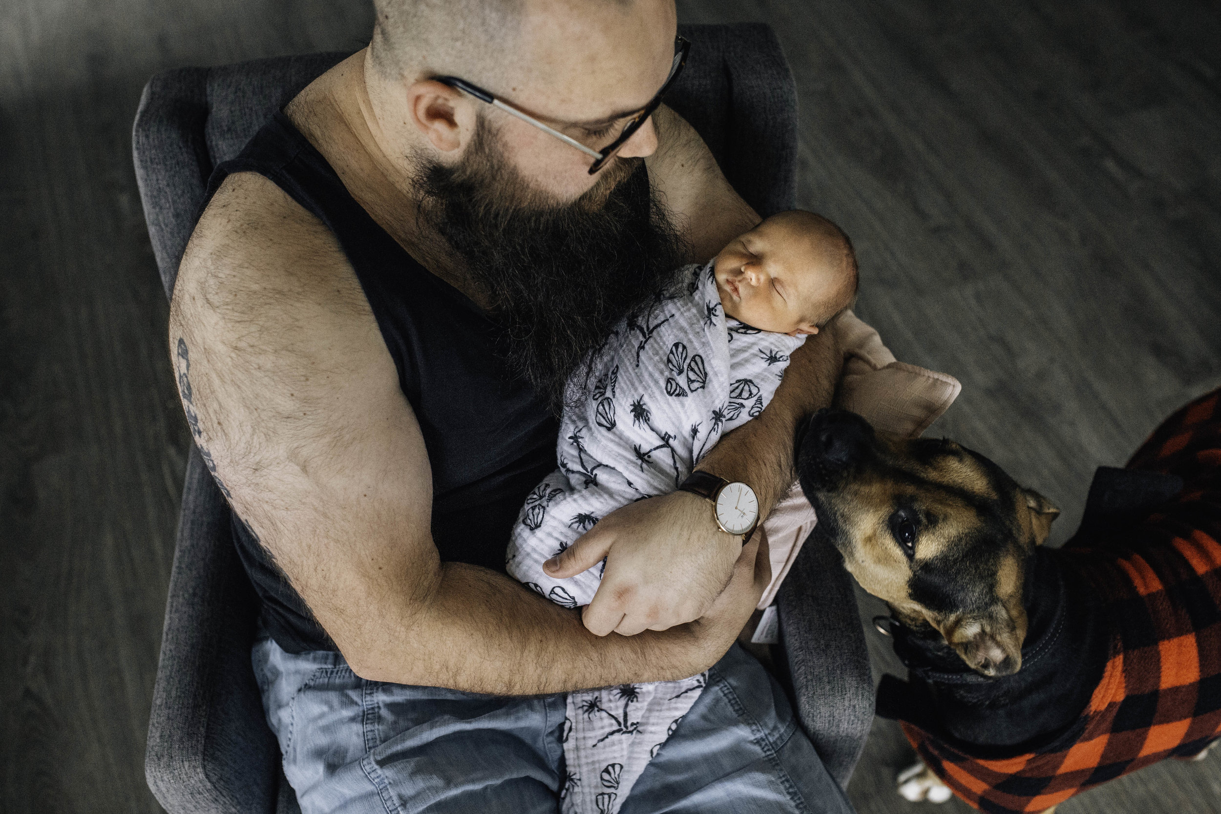 father-and-dog-with-newborn.jpg