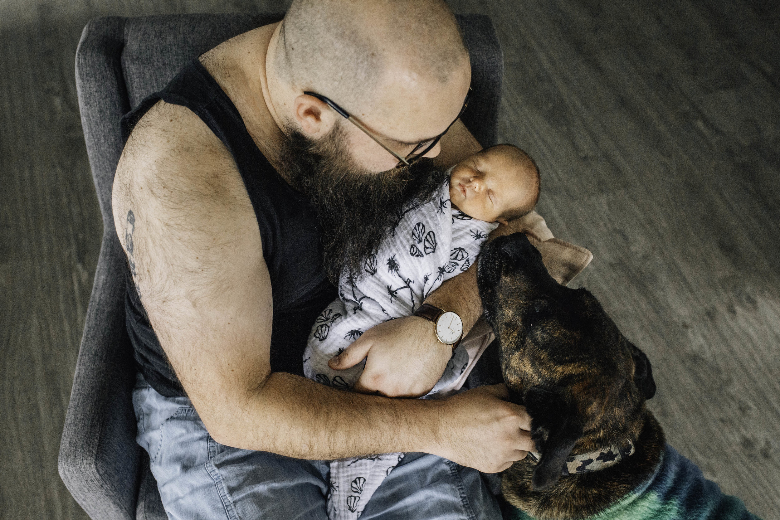 father-and-older-dog-loving-up-baby.jpg