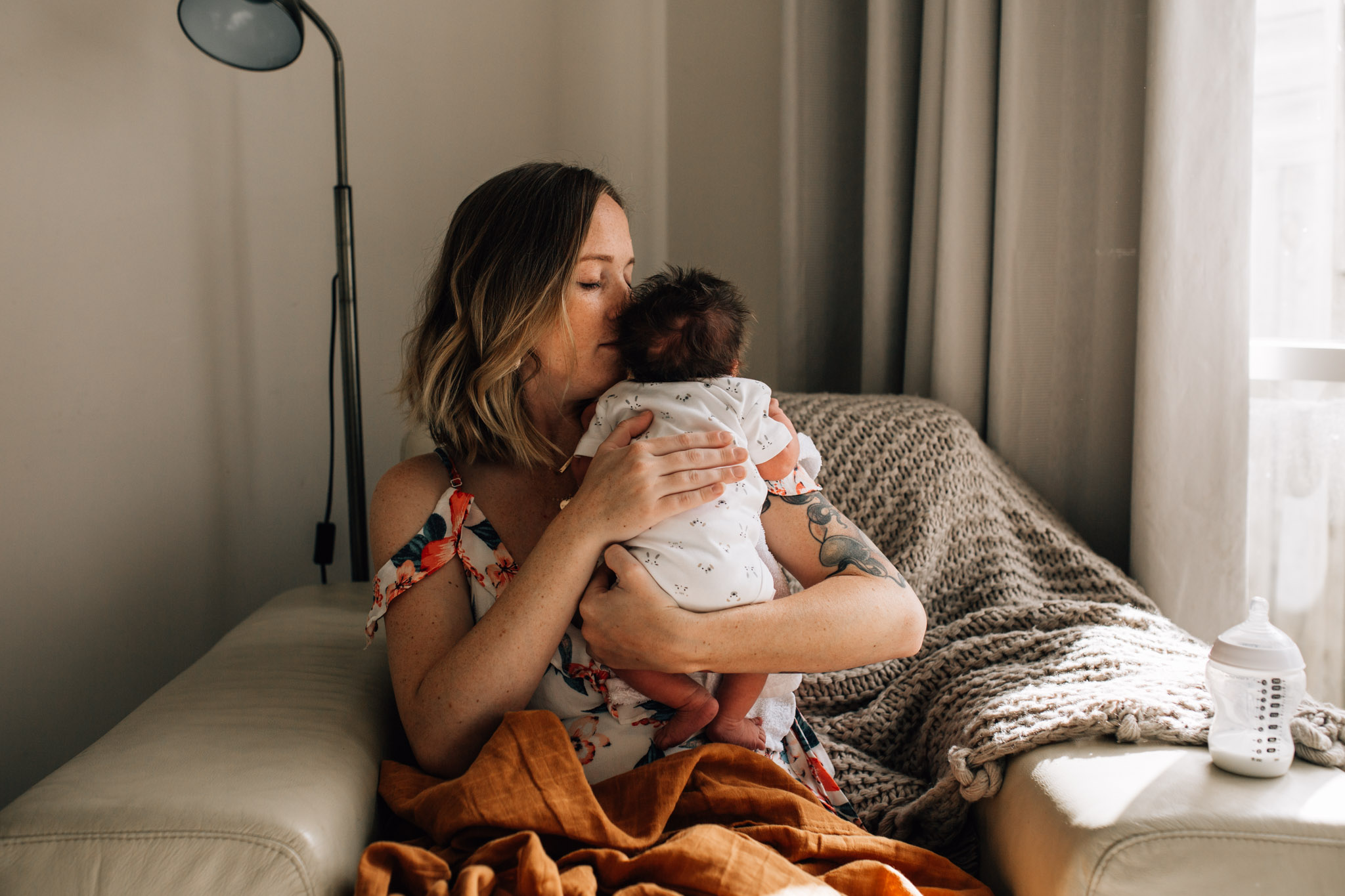 mother-kissing-infant (1 of 1).jpg