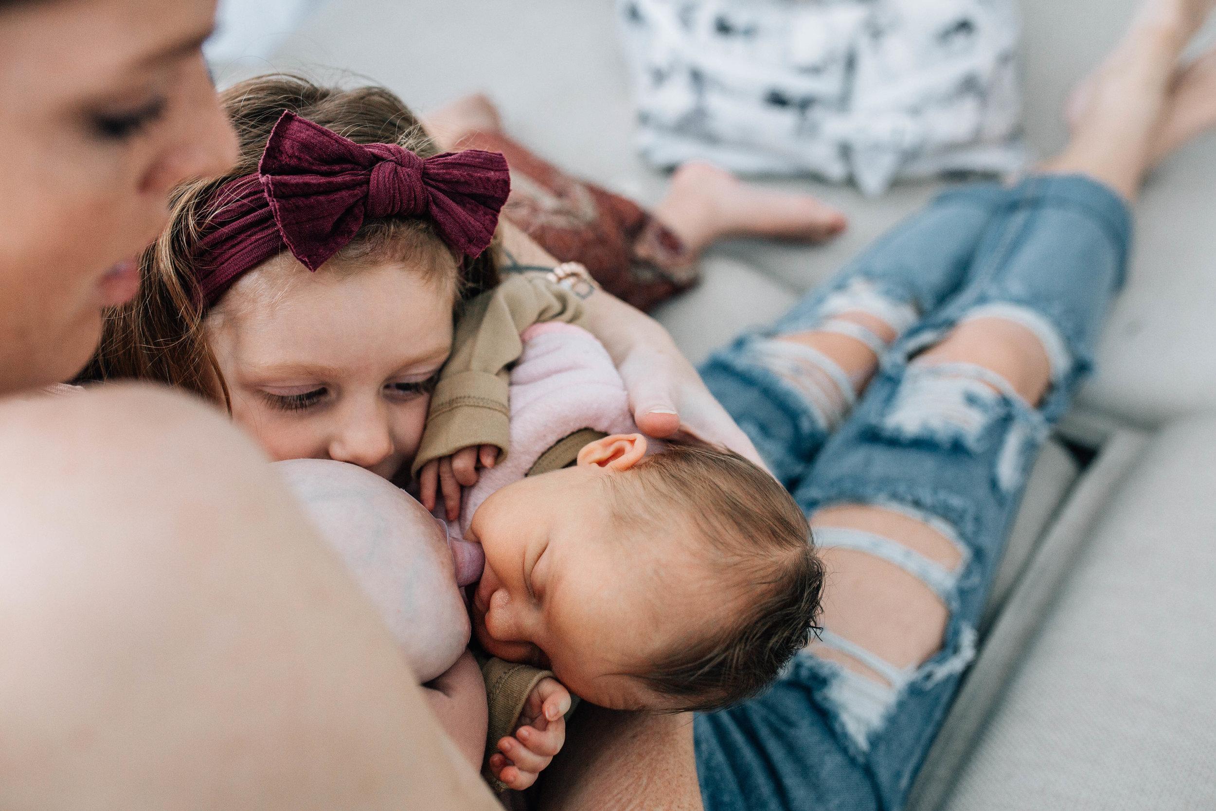 baby-breastfeeding-and-sister.jpg