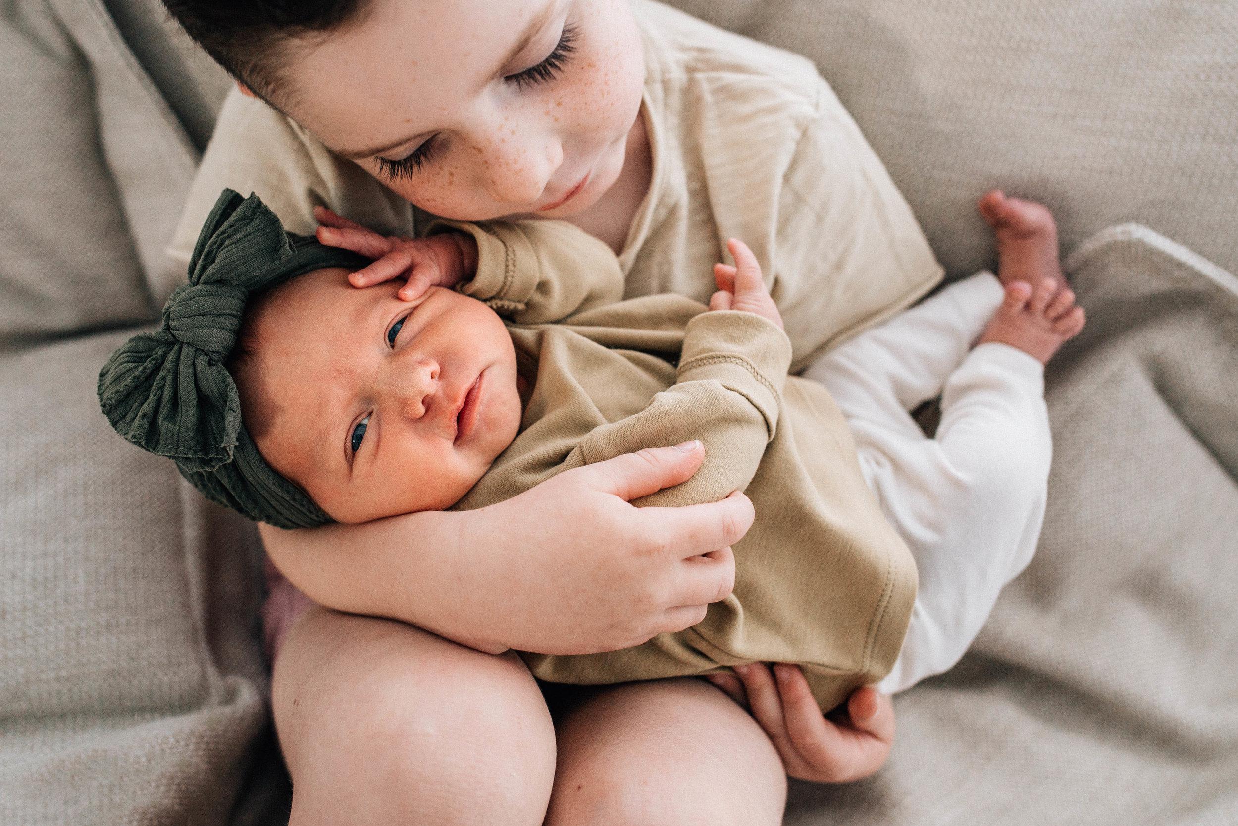 brother-and-newborn-sister.jpg