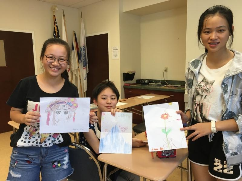 International camp students display their drawings