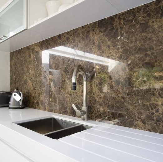 This is a full height stone backsplash but the same principal applies. Solid color top, patterned backsplash.  Source -  Houzz