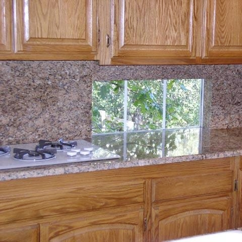 Speckled patterned granite. The pink undertone in the stone is not a good choice for orange oak.  Source -  MIStones