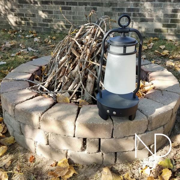 The Kichler Lyndon Portable Bluetooth LED Lantern Outside  by Fire