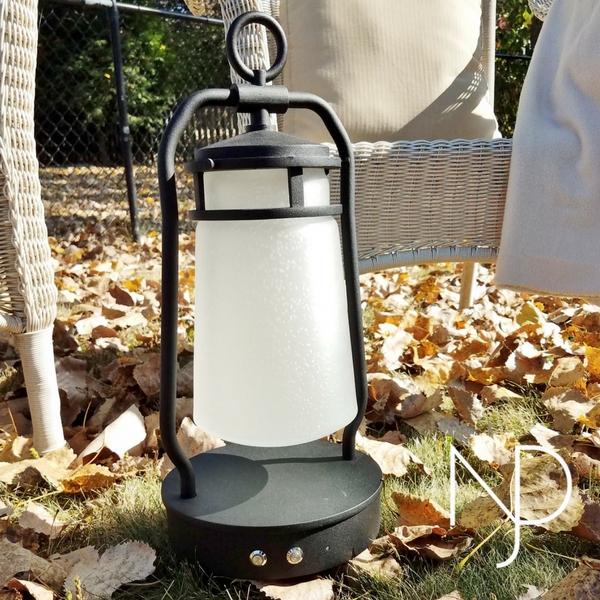 The Kichler Lyndon Portable Bluetooth LED Lantern Outside Buttons