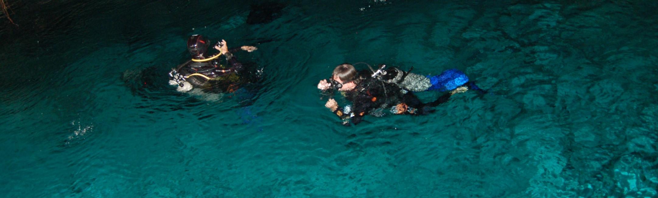 two divers descend into Dos Ojos cave, Yucatan