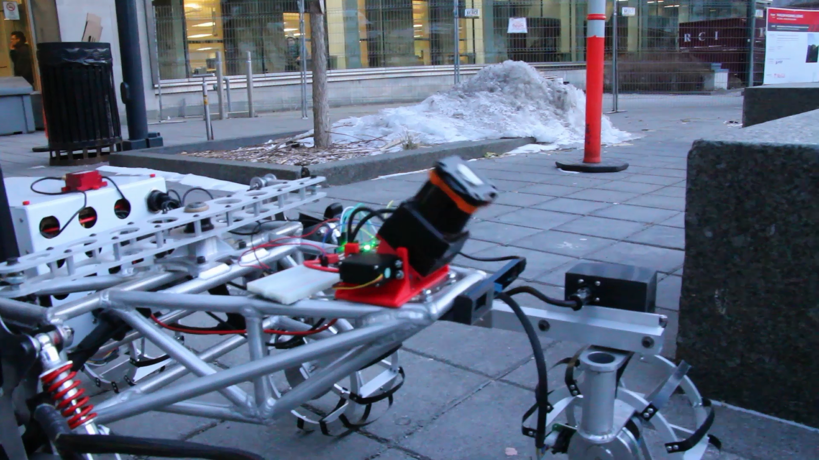 For the autonomous navigation task, our rover uses a tilting LiDAR and RGBD camera for obstacle avoidance (on this picture) and also uses other instruments such as an attitude sensor and GPS for general odometry and path planning.