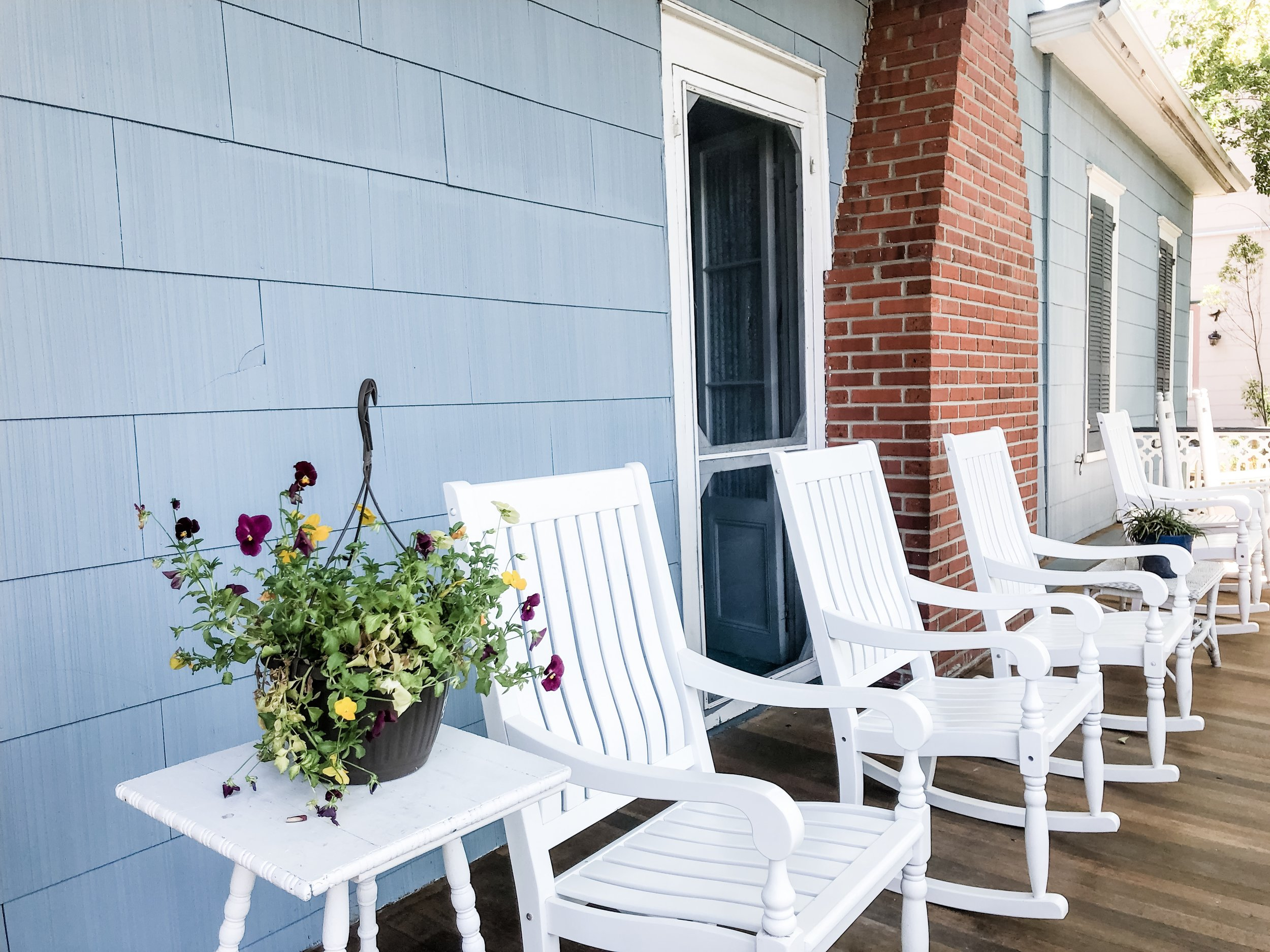 Enjoy morning tea or a chat on the front porch of the historic Holiday House