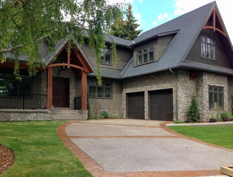 E20-calgary-custom-home-beautiful-stone-exterior-timber-trusses-750x570.jpg