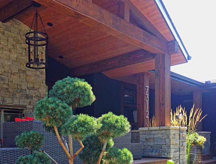 E28-calgary-custom-home-mid-century-modern-exterior-fireplace1-750x570.jpg