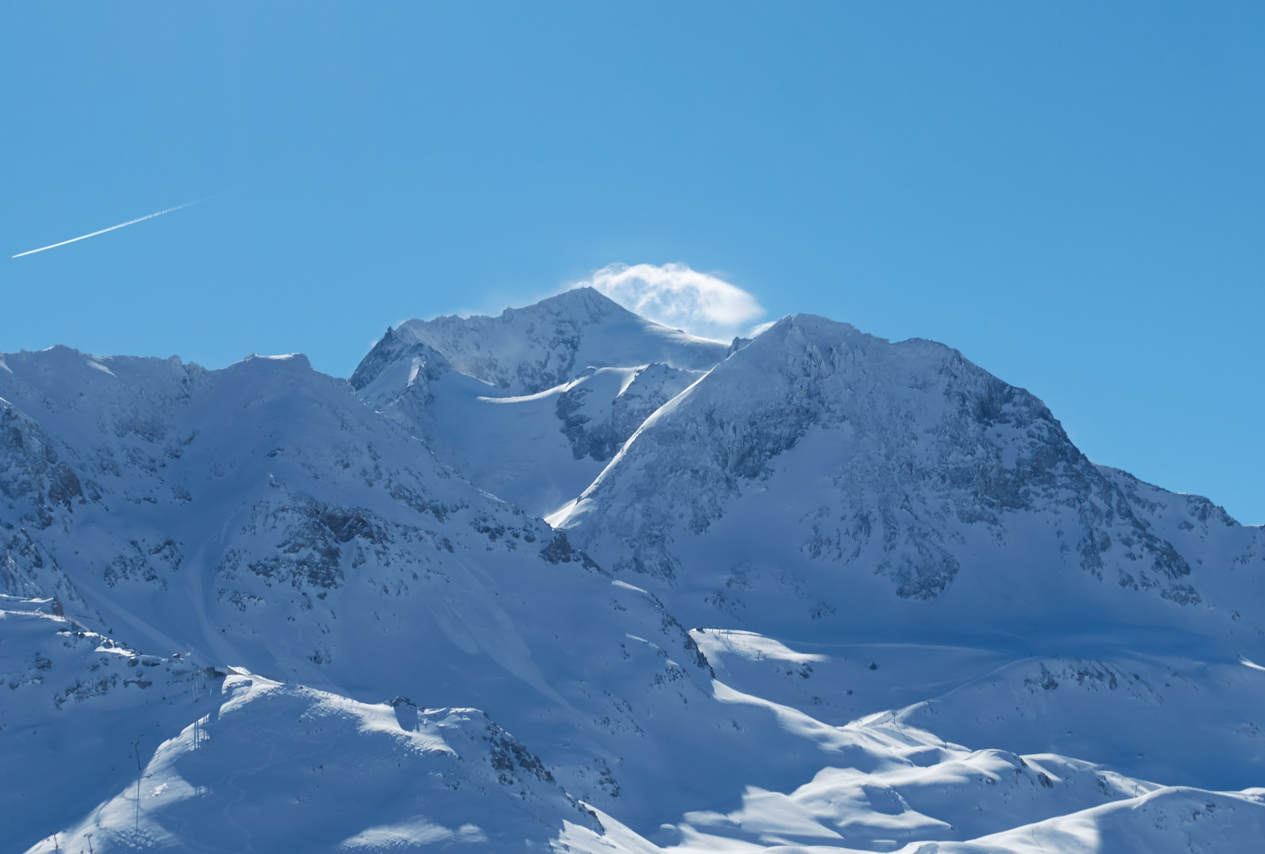 Avalanche control: snow powder rising after a controlled avalanche release explosion.