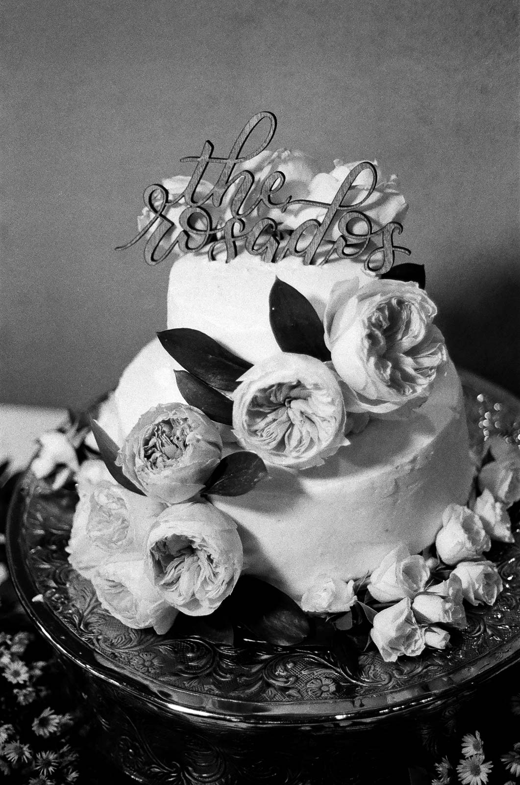 black and white 35mm film Photograph of Wedding cake taken by Joseph Barber wedding photography newport beach