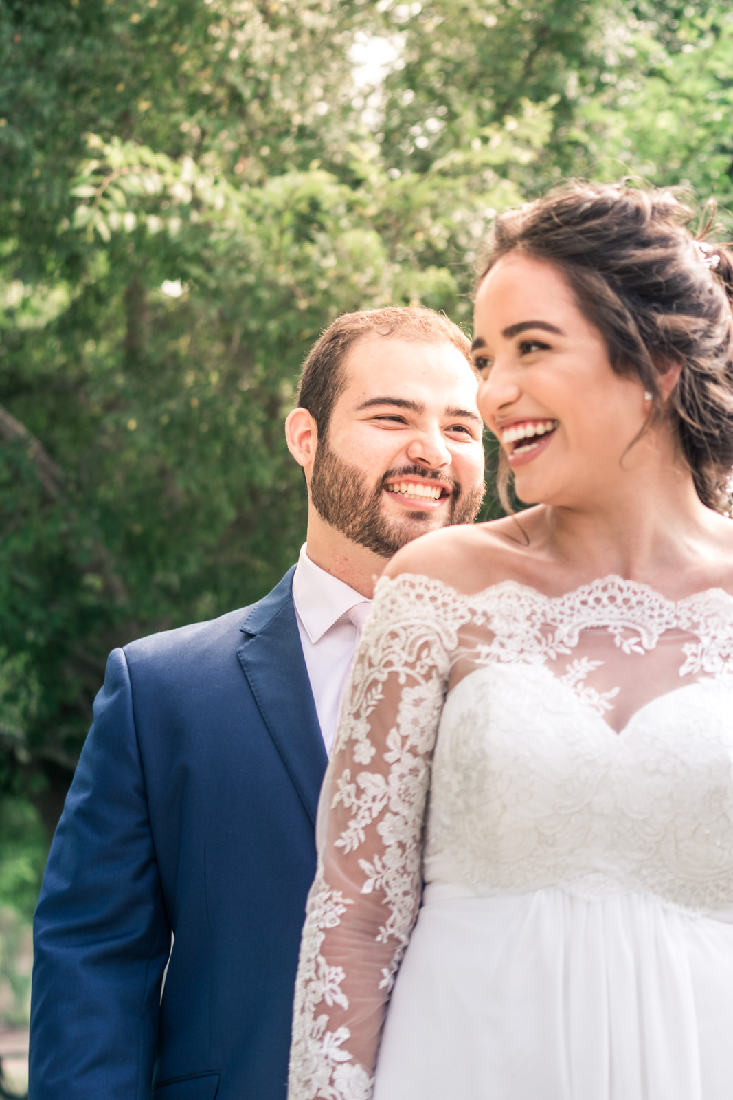 Portrait of the Bride and groom laughing and smiling   during the first book on their wedding day in Brea California