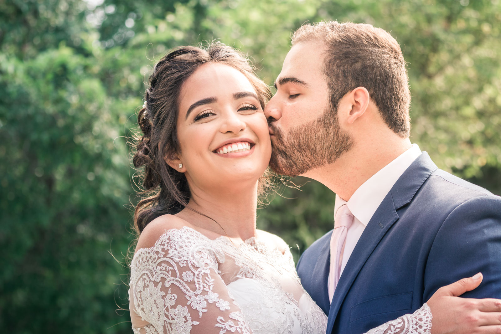 Portrait of the Bride and Kissing and smiling during the first book on their wedding day in Brea California