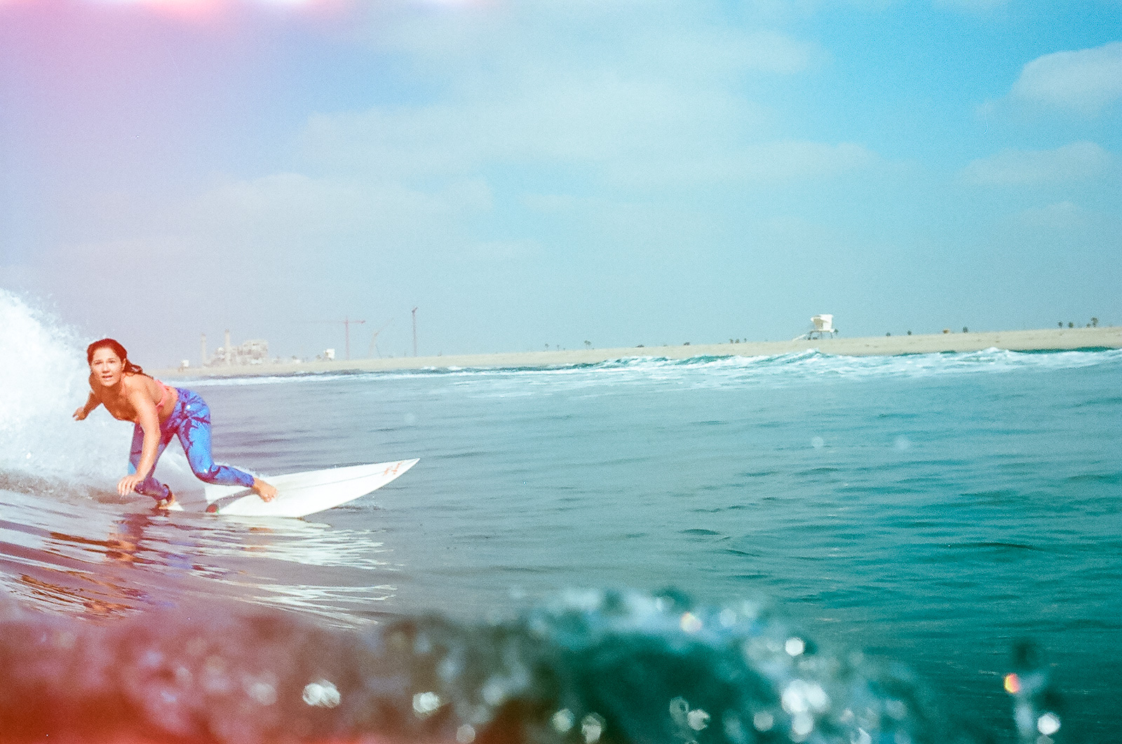 35mm color film Surfing photo shoot in the water at Huntington State Beach with girl surfer surfing  for Get wise fool eco-friendly surf company