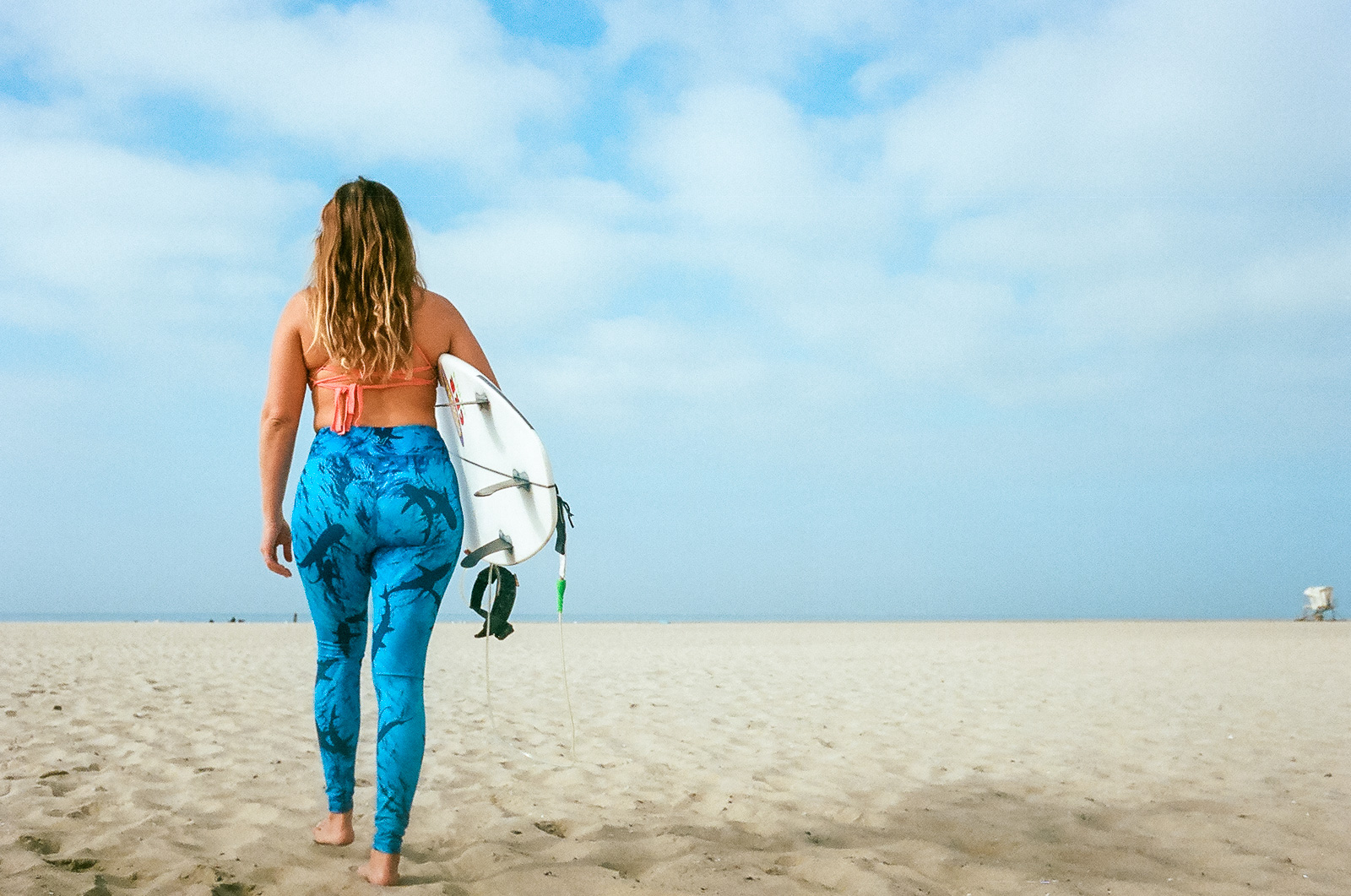 35mm color film Surfing photo shoot at Huntington State Beach with girl surfer for Get wise fool eco-friendly surf company