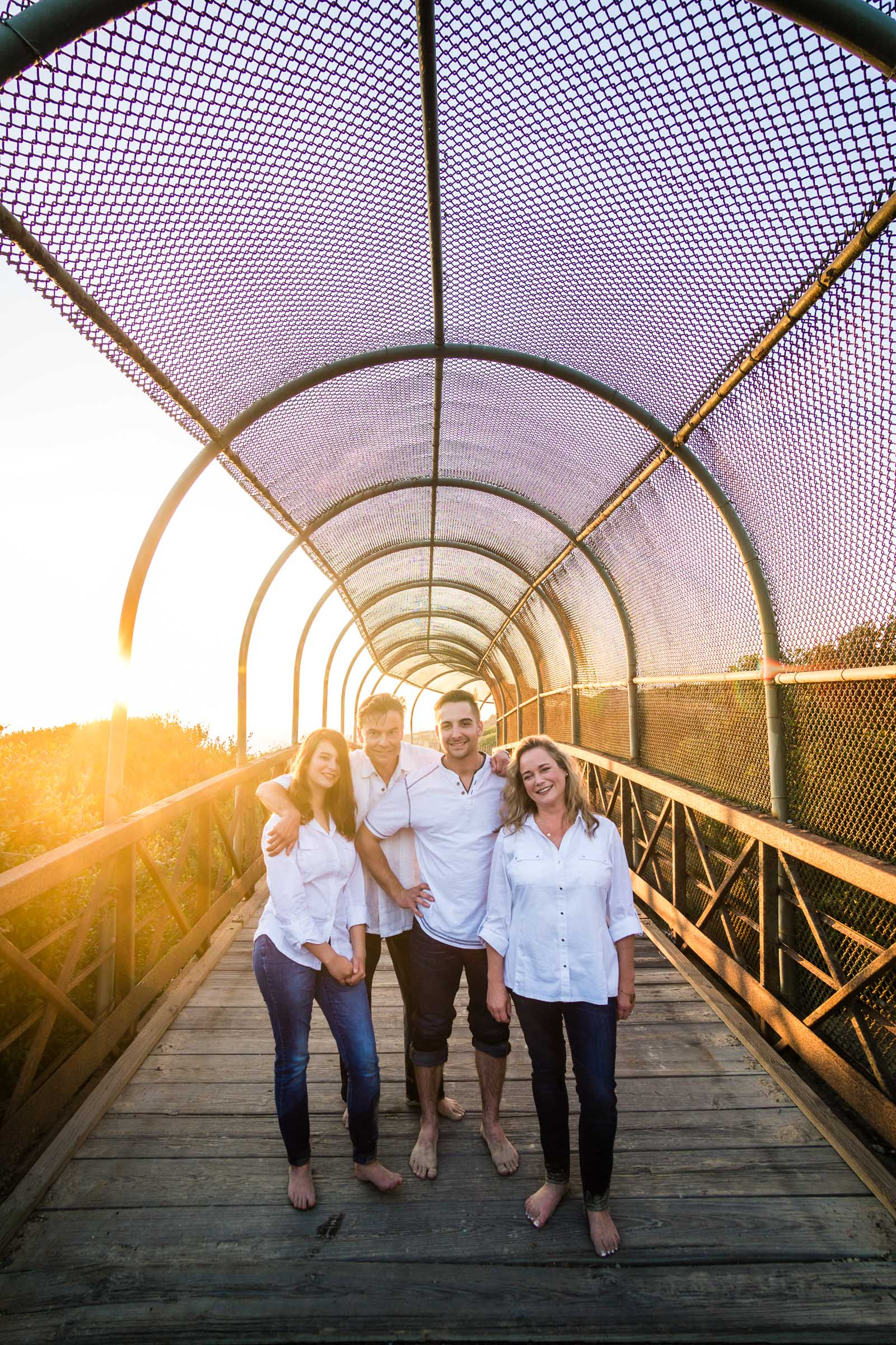 Family portraits what a night Arch Composition during Golden hour at Crystal Cove State Beach in Newport