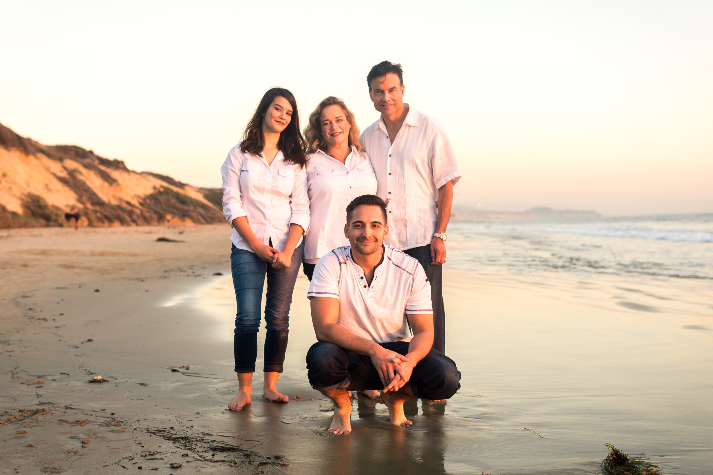 Family portraits of family enjoying the sunset together during Golden hour at Crystal Cove State Beach in Newport