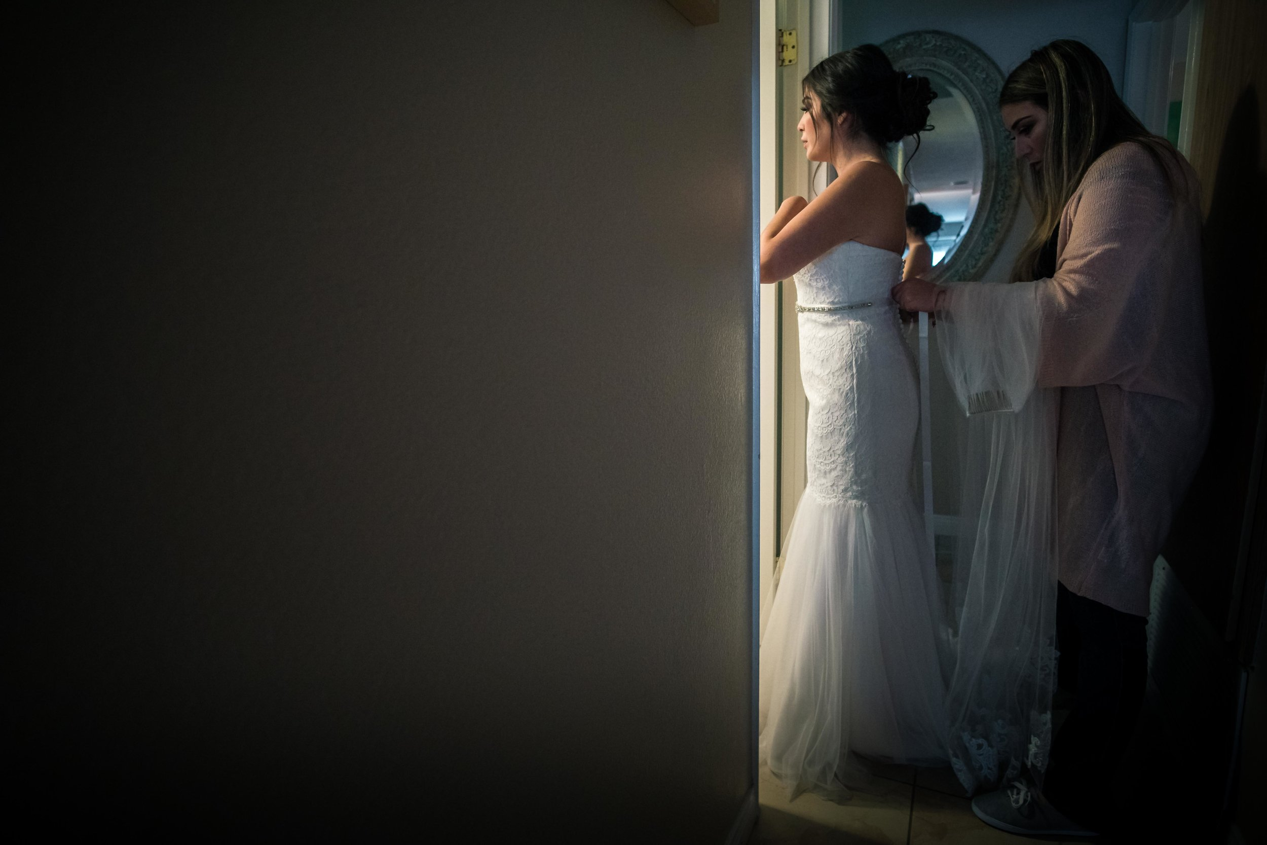 A minimal composition of the bride getting ready with your mother During her wedding preparation