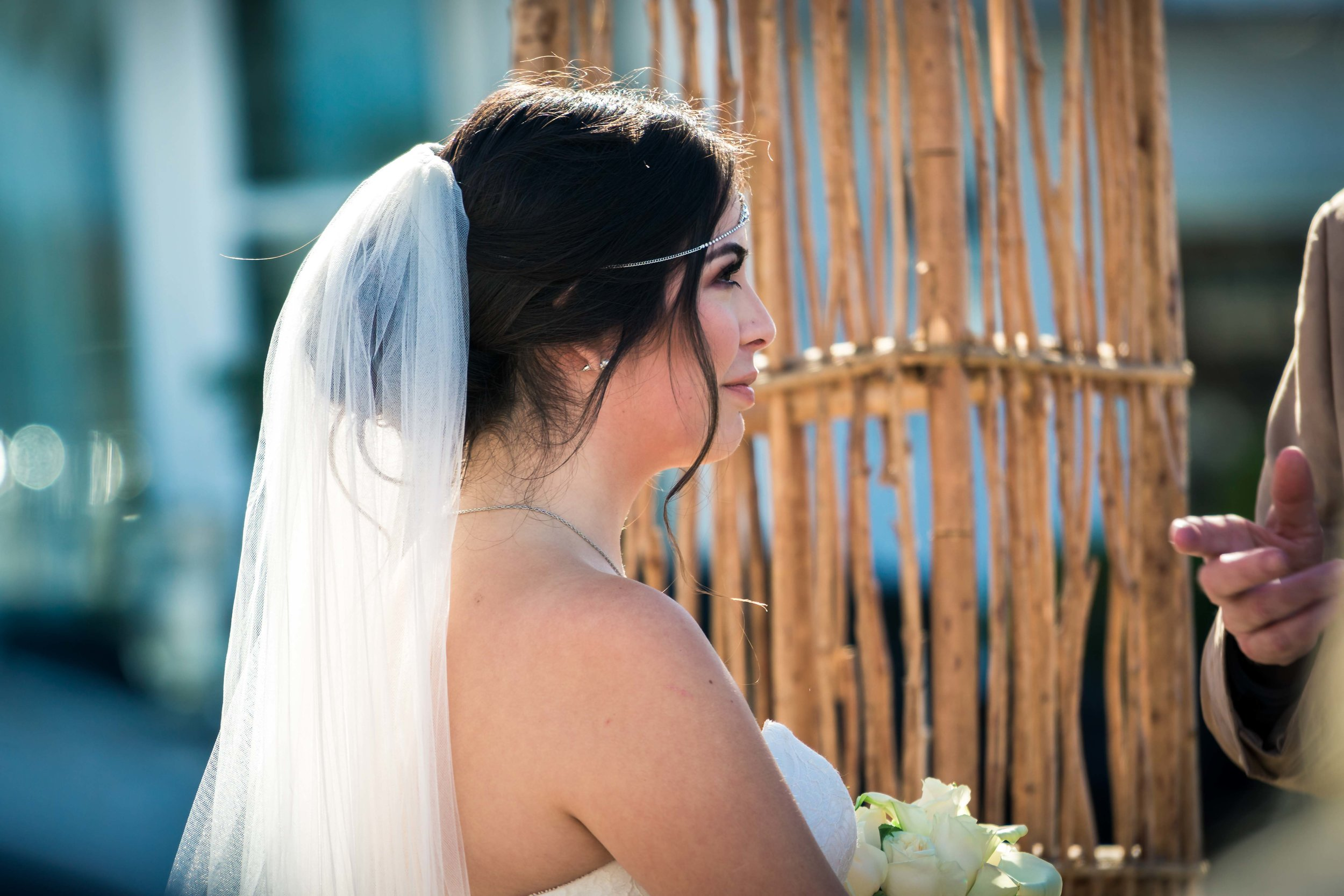 The bride with her veil at the alter