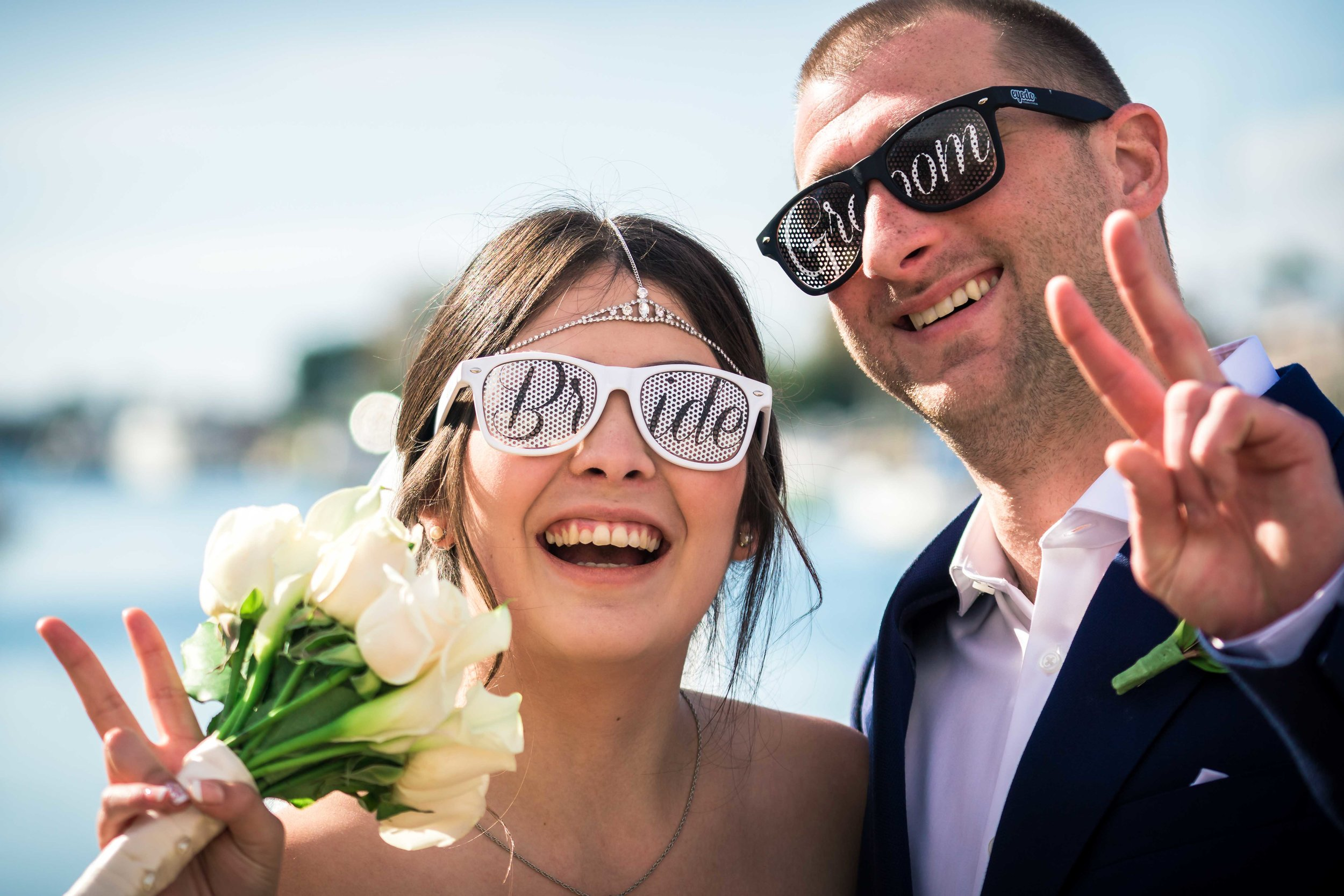 Bride and groom wearing sunglasses and being goofy