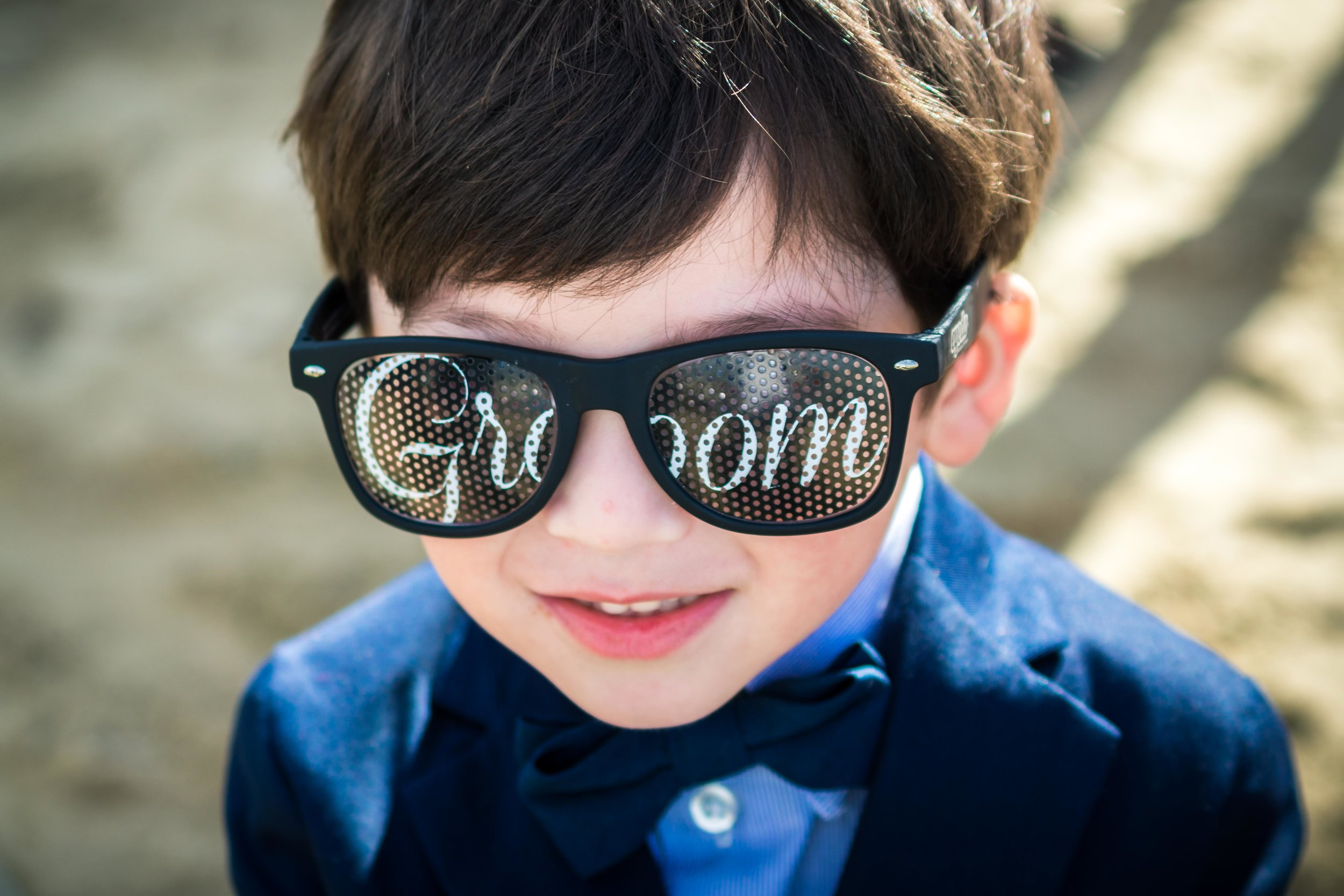The ring bearer wearing sunglasses that Say groom