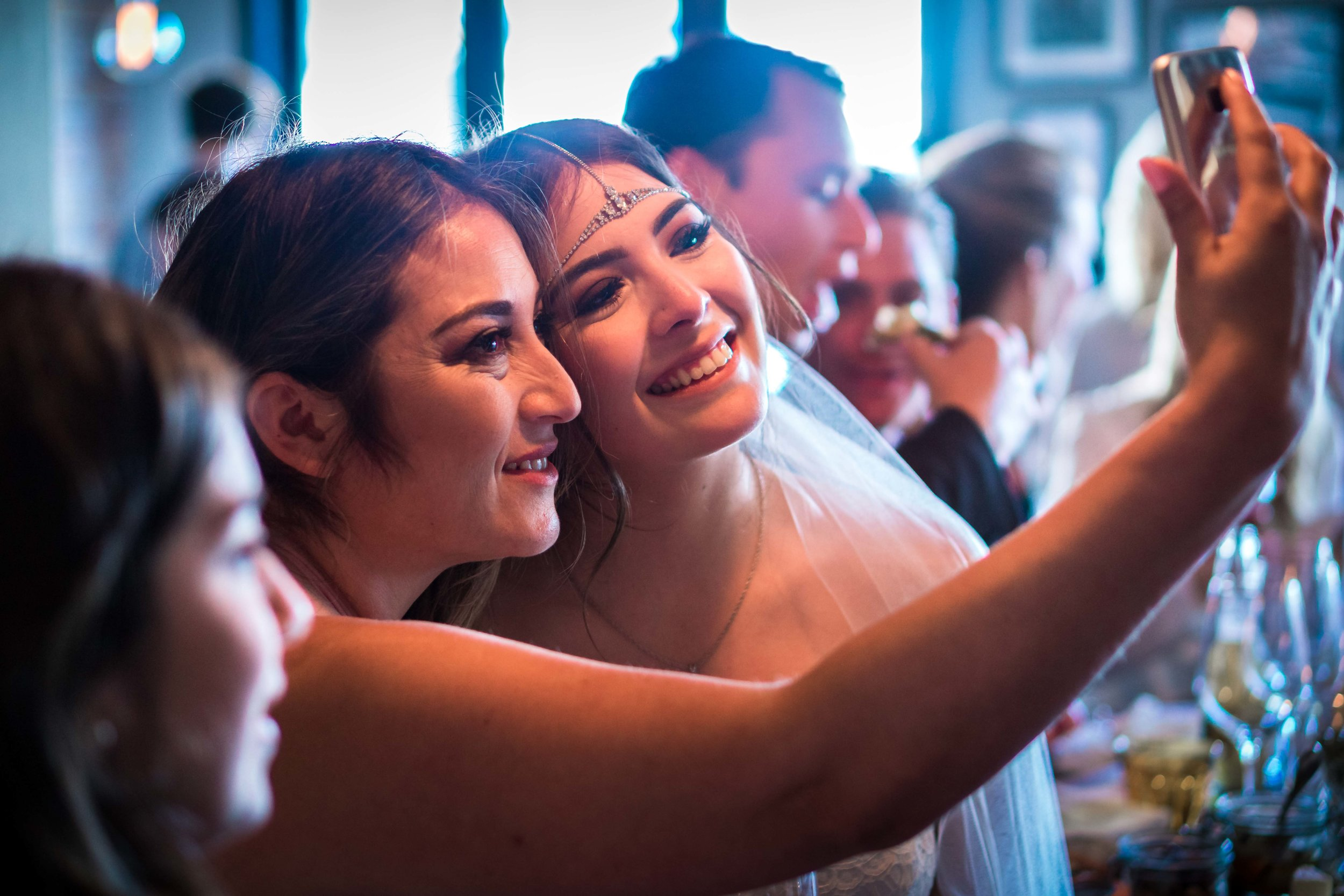 Bride and her mom taking a selfie at the wedding reception at the Royal hen restaurant