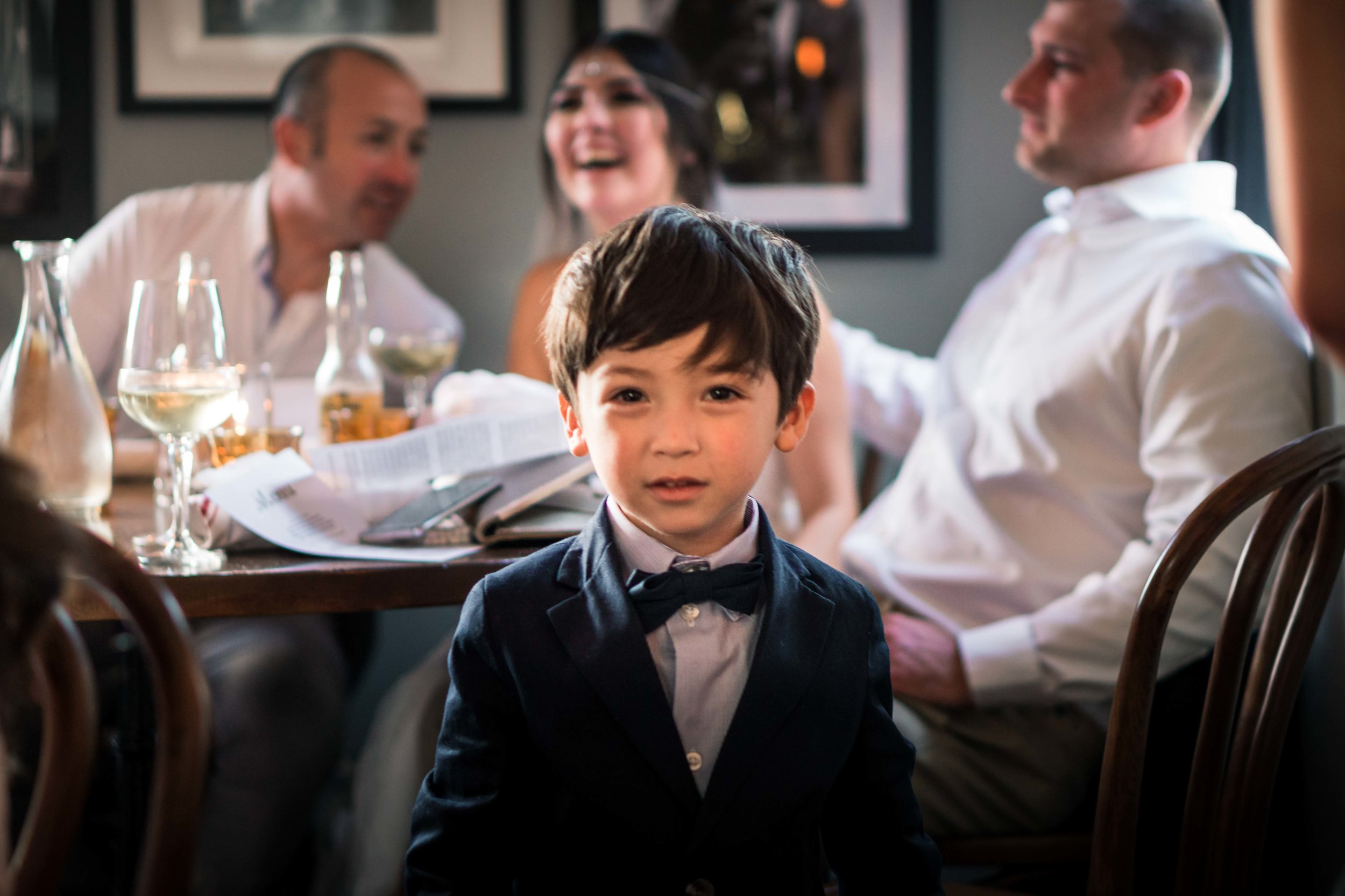 Cute photo of the ring bearer boy looking  At the camera