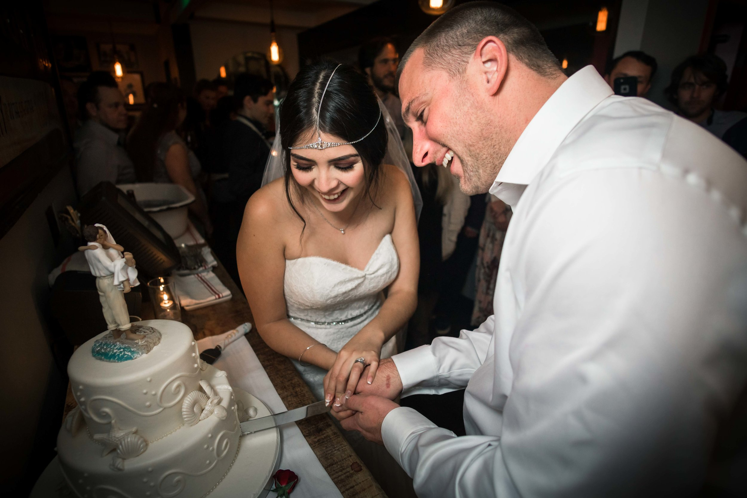 The wedding couple cutting the cake